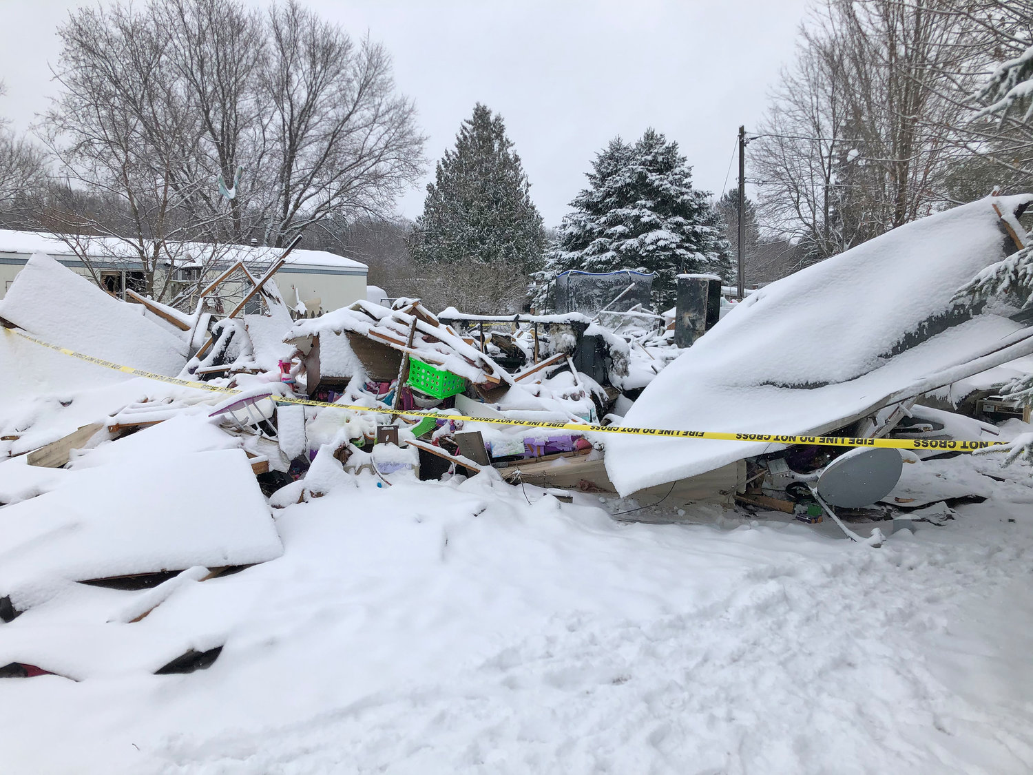 "'LIKE A BOMB WENT OFF' — Freshly fallen snow this morning covers all that remains of a mobile home caught in a propane explosion at the Quiet Valley Trailer Park in Vernon Sunday night. Fire officials said it was ""like a bomb went off"", with the force of the blast damaging several nearby homes. Three residents — a mother and her two young daughters — remain hospitalized today with burn injuries."