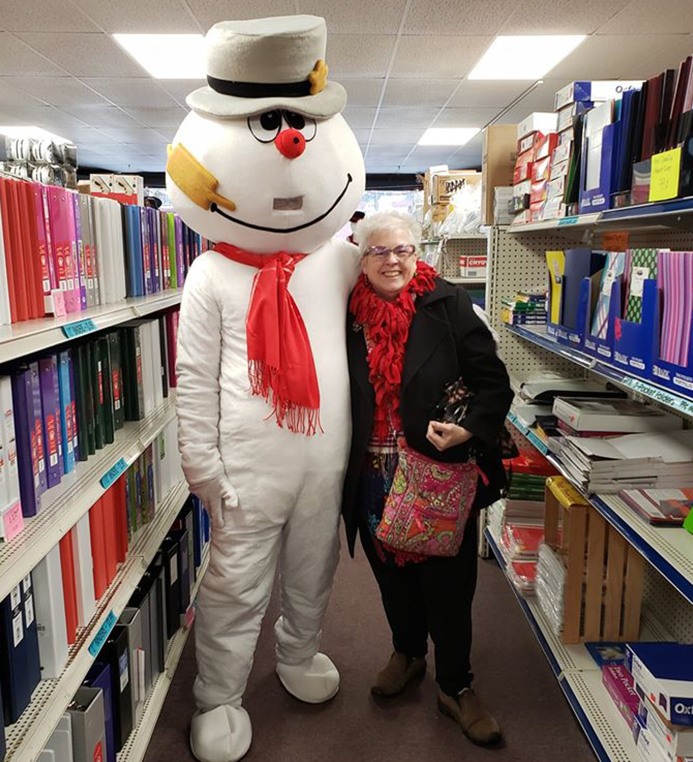 HAPPY, JOLLY SOUL — City of Oneida Mayor-Elect Helen Acker poses with Frosty the Snowman at Oneida Office Supply for the Oneida Christmas Story Downtown Stroll on Sunday, Dec. 1.