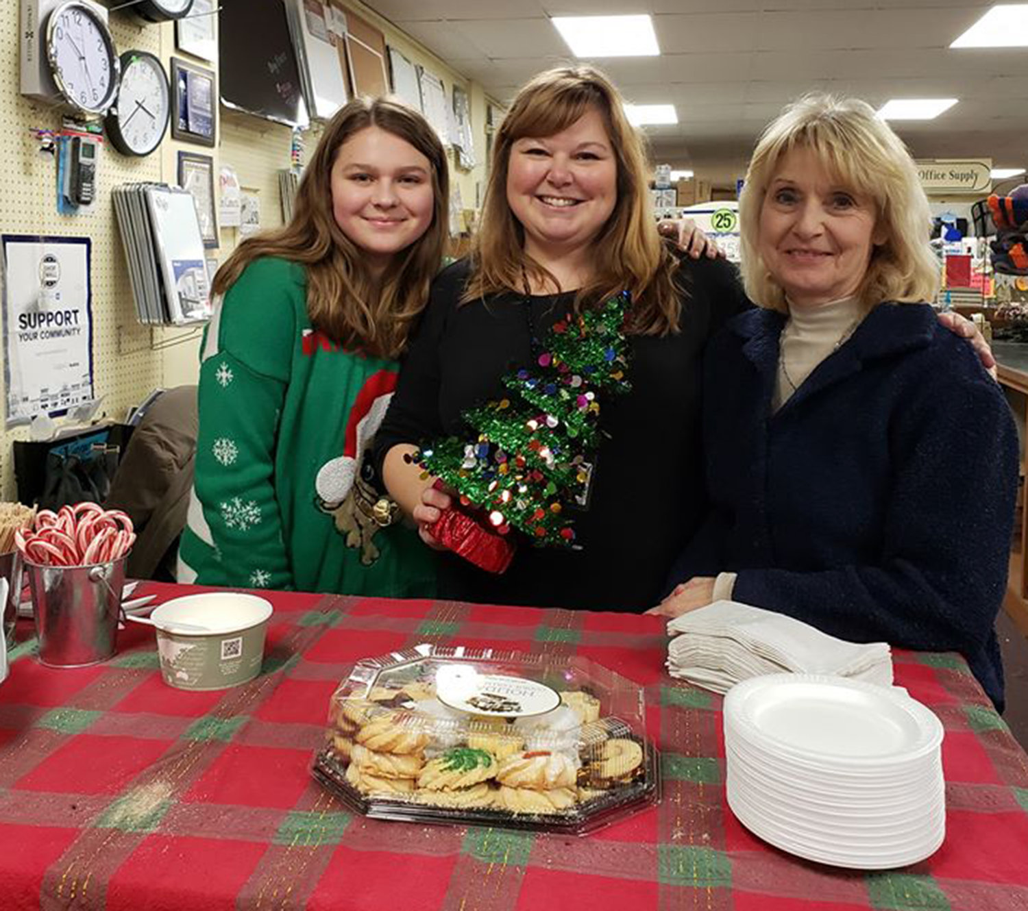 CHRISTMAS TREATS — Oneida Office Supply welcomes residents in for a cookie or two for the Oneida Christmas Story Downtown Stroll on Sunday, Dec. 1.