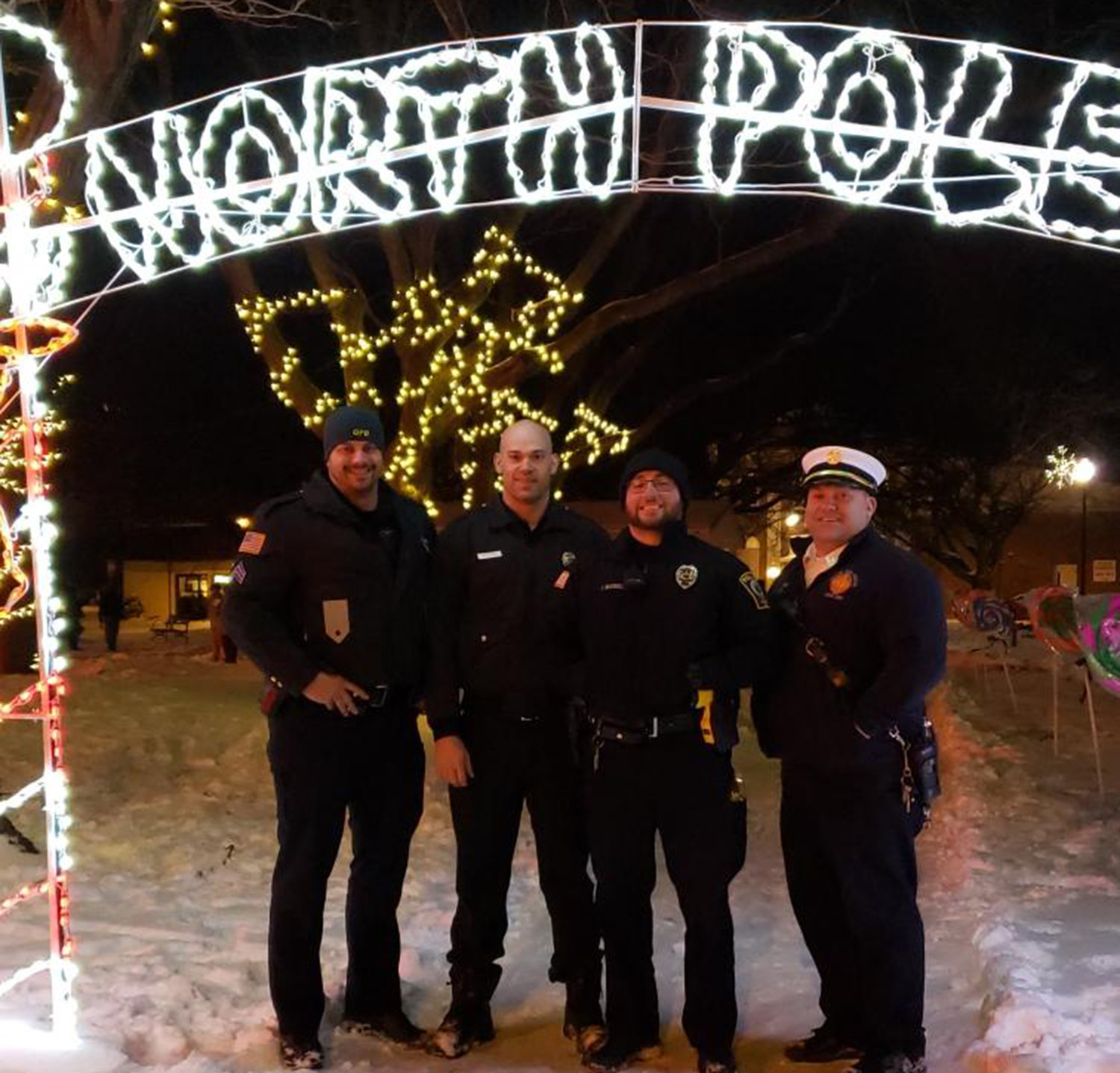 HOLIDAY HEROES — The Oneida City Police Department and Oneida City Fire Department joins in for the holiday festivities at the Oneida Christmas Story Downtown Stroll on Sunday, Dec. 1.