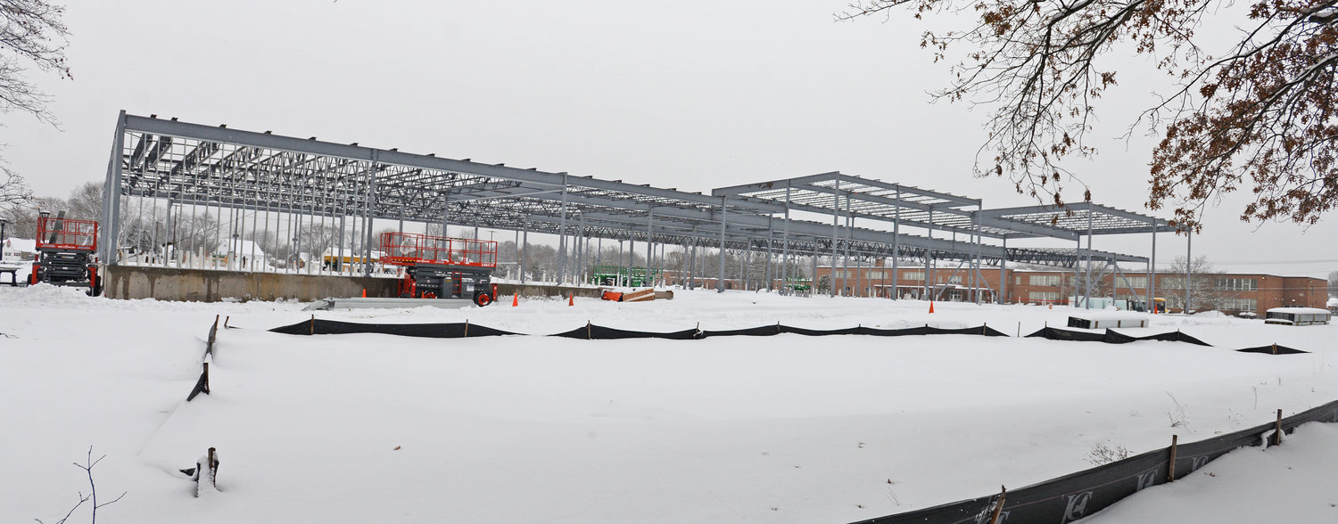 "RISING STEEL -  In this Monday, Dec. 2 photo, progress is shown on the under construction Hannaford supermarket. The frame for the new supermarket went up within the last week Mayor Jacqueline Izzo said on Monday.  ""They'll be working through the winter,"" she noted. In October, the foundation was laid for the 49,000-square-foot store at the corner of Chestnut and Turin streets. Once completed, the location will include a bottle and can return center, drive-thru pharmacy and a pickup window for online shopping service, Hannaford To Go."