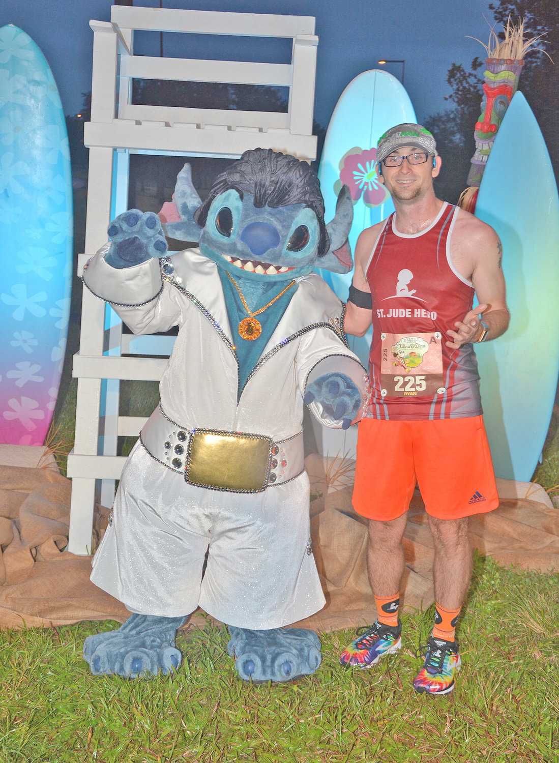 "MAKING FRIENDS — Runner Ryan Dugan, of Clinton, takes time for a fun photo with Stitch, a character from the Disney film ""Lilo & Stitch,"" down in Walt Disney World in Orlando during a runDisney event."