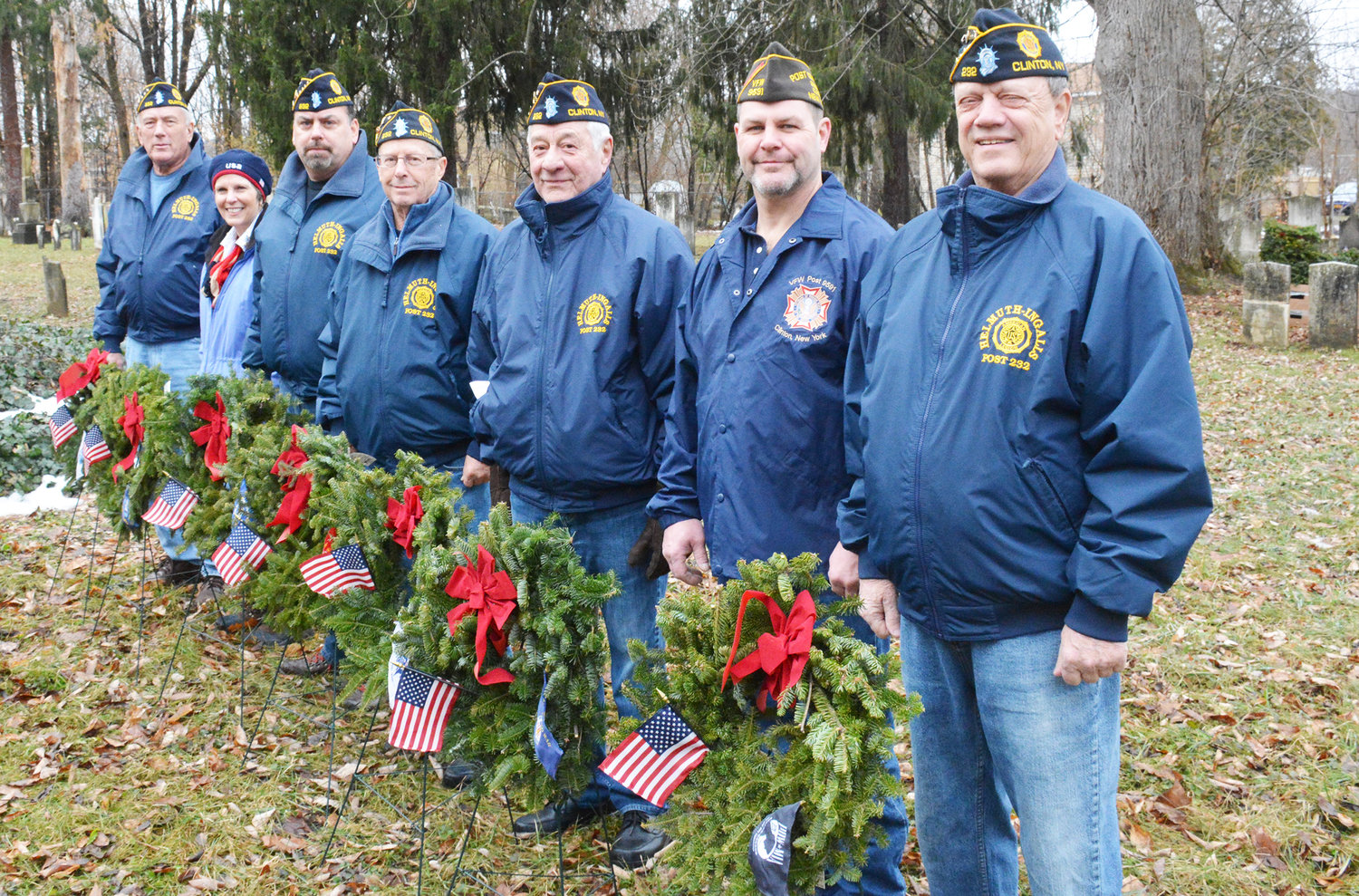 DUTY AND HONOR — Members of the American Legion Helmuth-Ingalls Post 232 and Skenandoah Chapter of the DAR participated in the Wreaths Across America memorial at the Old Burial Ground in the Village of Clinton on Saturday, Dec. 14. Pictured from the left: Bill White, Kimberly Haley, John Nolan, Kern Shilkret, Frank Savino, Chet Stuttler and Commander George Reschetnikow.