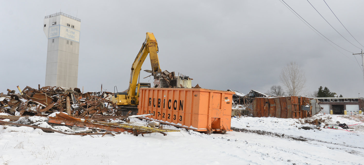 CLEAN UP — Excavator picking through the metal at the former Rome Cable site on Jan. 8, 2020.