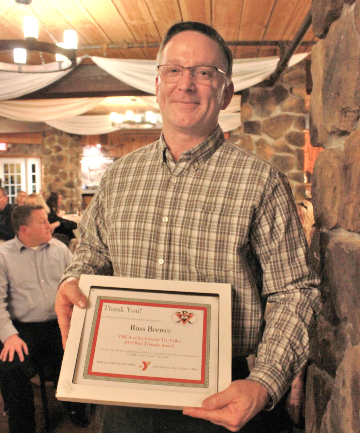 RED TRIANGLE — Russ Brewer was awarded the Red Triangle at the annual YMCA 2020 Recognition Program on Wednesday.
