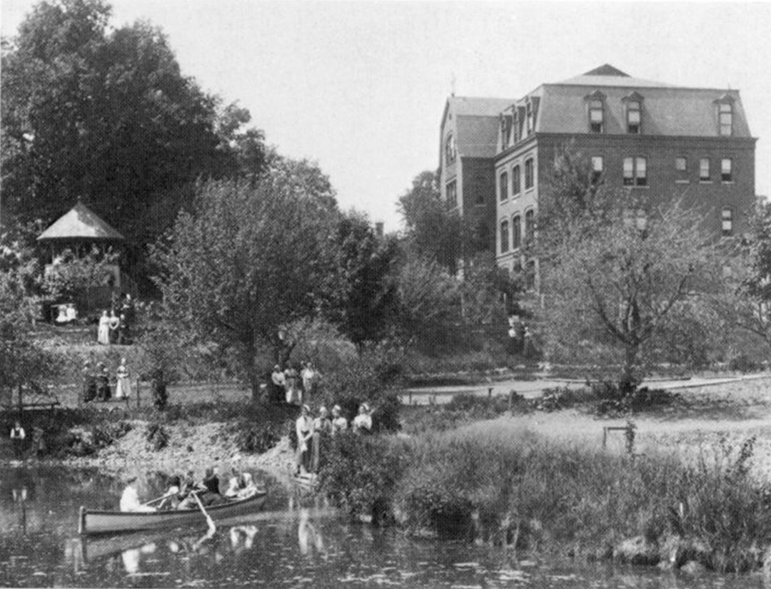POND PADDLERS — Academy of Holy Names students, with their beautiful old school in the background, enjoy strolling around the grounds and paddling a canoe in the pond.
