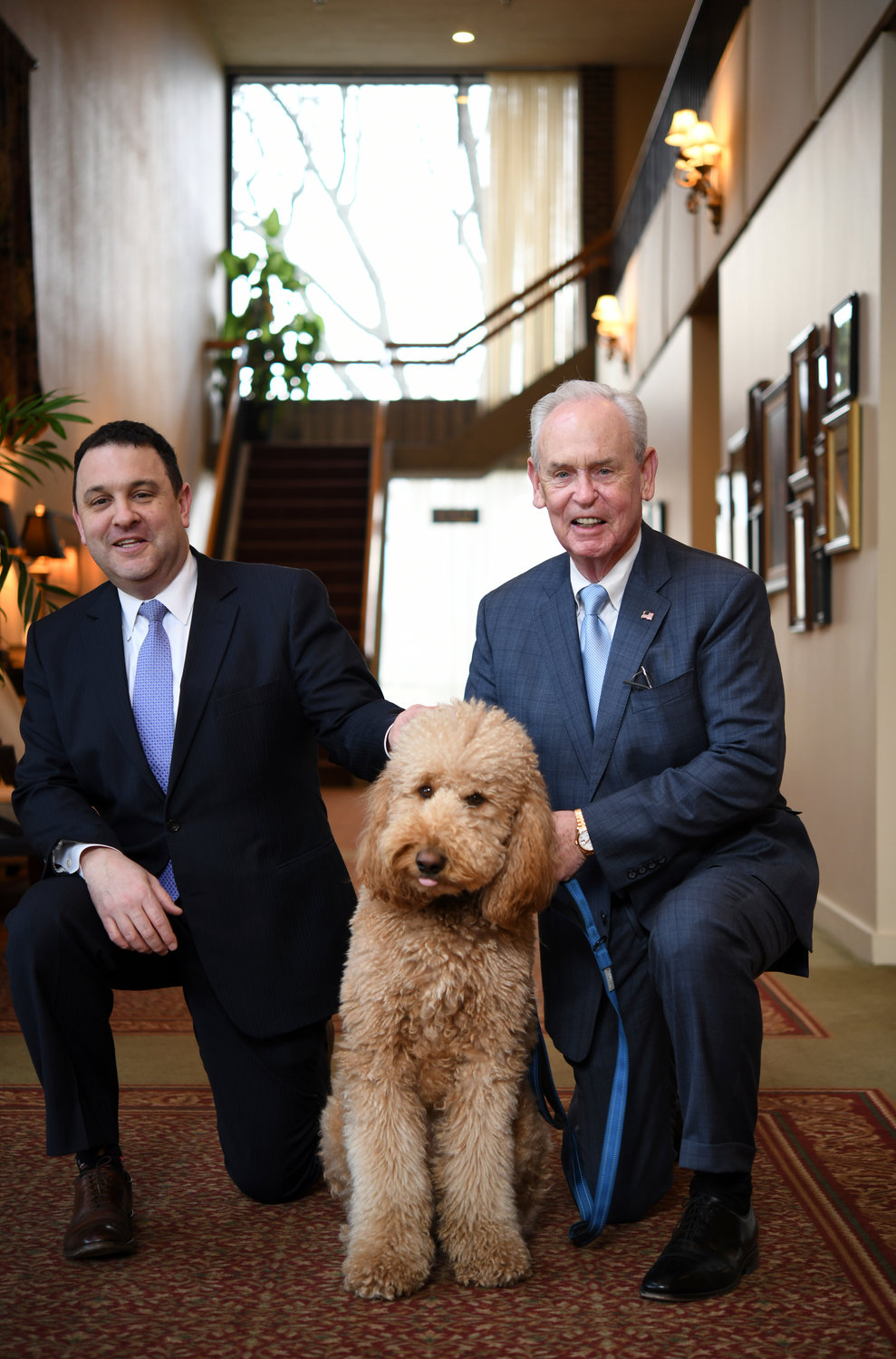 FAMILY BUSINESS — Bill Fay Jr. and Sr. with comfort dog, Teddy on at Callahan, Fay and Caswell Funeral Home in Worcester, Mass. The funeral home marks its 150th anniversary.
