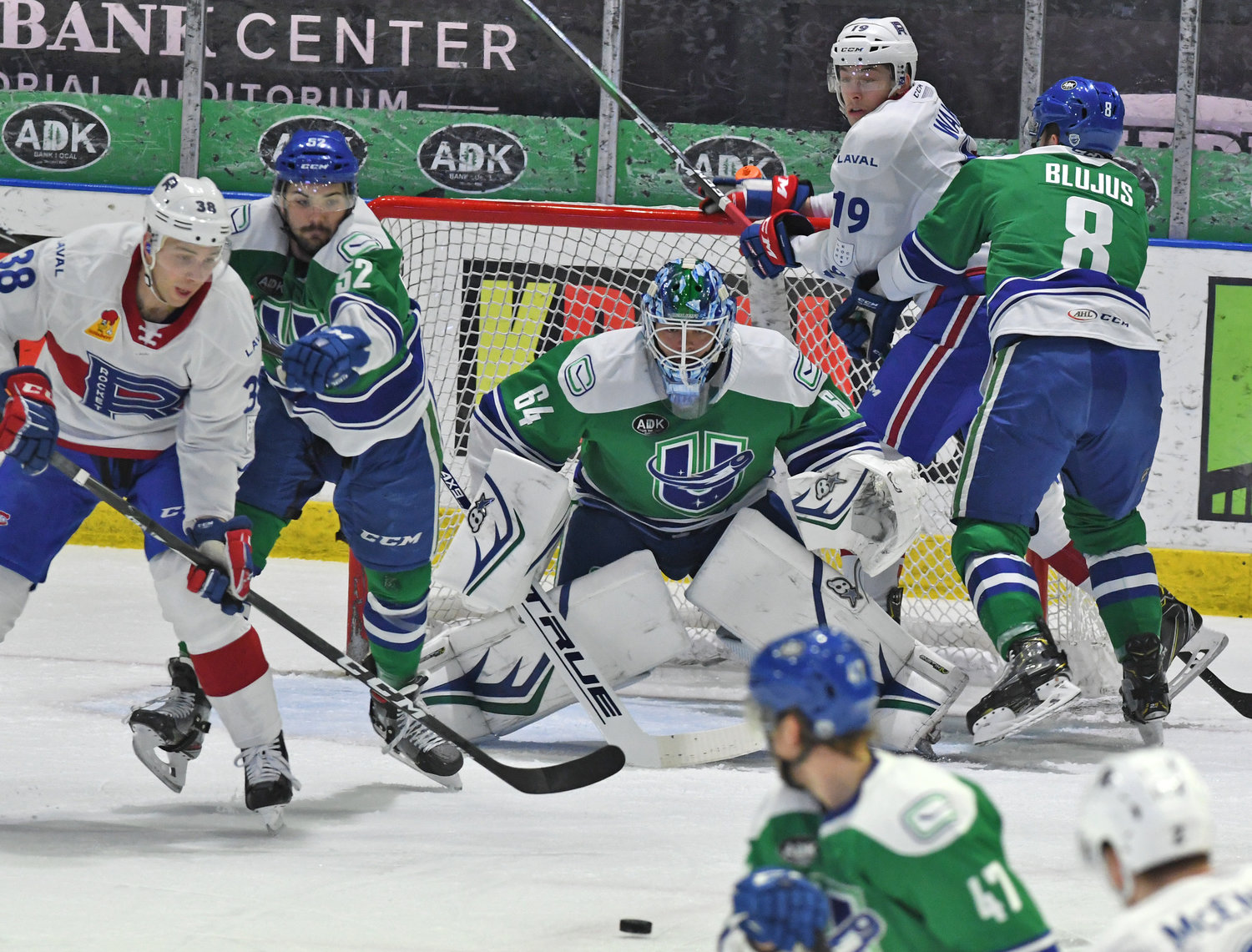 INCOMING — Comets goalie Michael DiPietro watches the puck as Laval players crash the net. Utica defensemen Mitch Eliot, left, and Dylan Blujus help keep the path clear. DiPietro stopped 28 shots and Utica won 3-2 at the Utica Aud Wednesday.