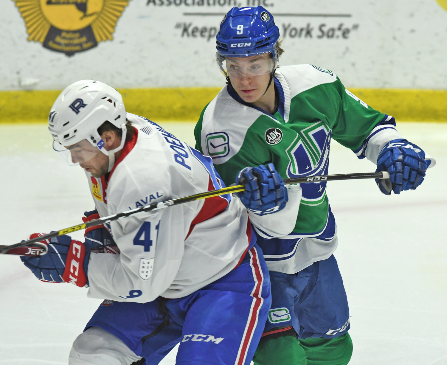 Comets #9 holds back Laval #41 in the first period.