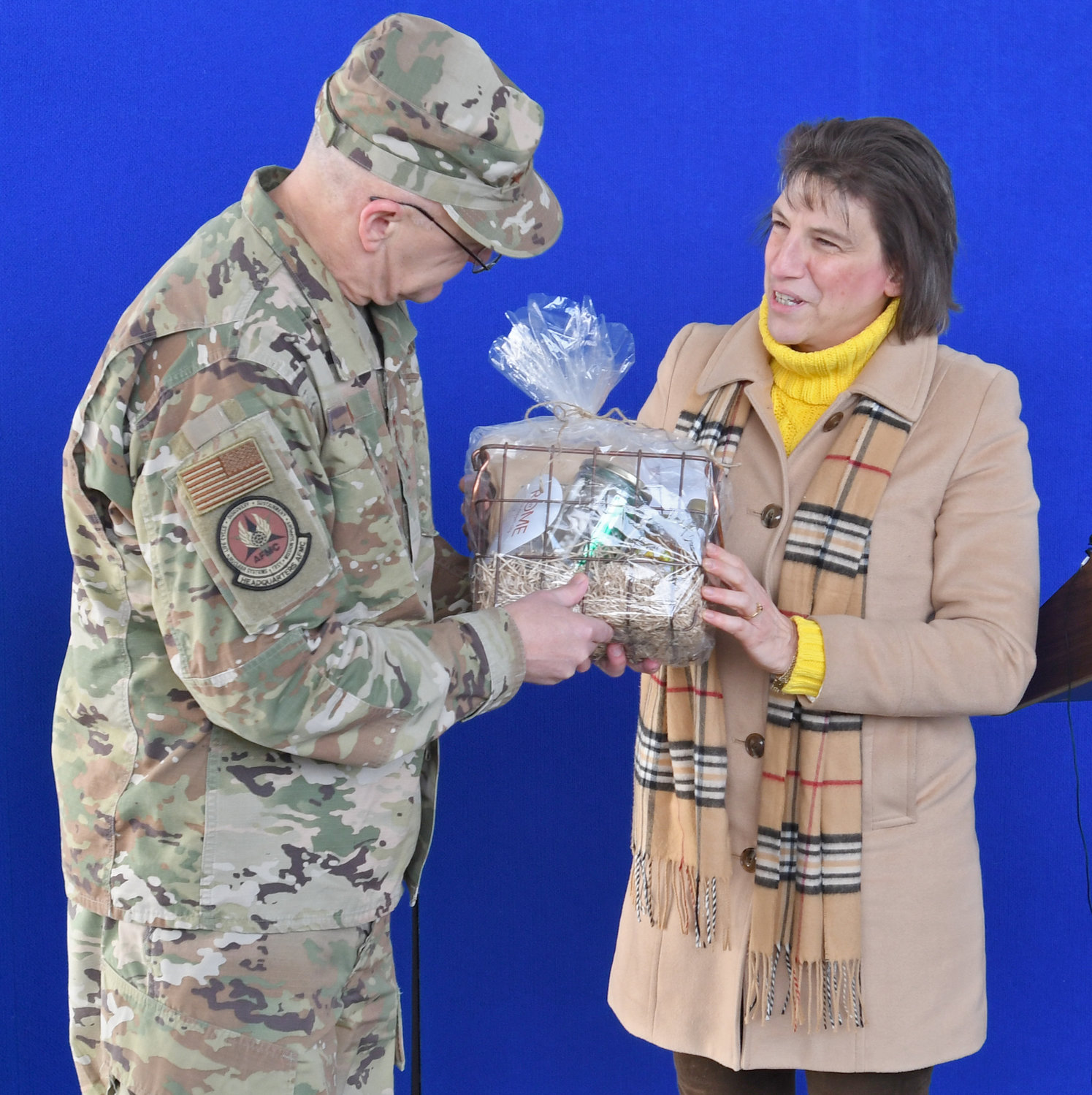 "SOMETHING FOR THE GENERAL — During a groundbreaking ceremony Wednesday for a new perimeter security system at the Air Force's Rome Lab, Rome Mayor Jacqueline M. Izzo presents Air Force four-star Gen. Arnold W. Bunch, Jr. with a gift basket containing ""all things Rome."" Among some of the enclosed items were turkey joints, Broasters Coffee, locally made maple syrup and honey, and a Rome sticker. Bunch is commander of Air Force Materiel Command."