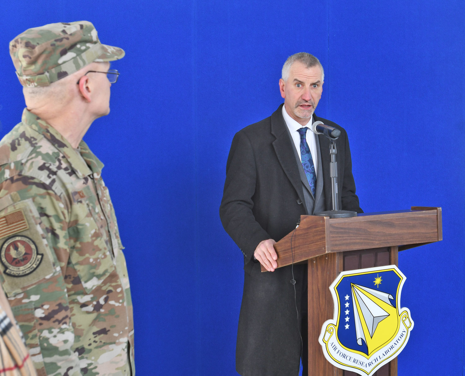 LAB'S ACTING DIRECTOR SPEAKS — Rome Lab acting Director Dr. Michael Hayduk addresses the audience during a groundbreaking ceremony Wednesday for a new perimeter security system at the lab. Looking on at left is four-star Gen. Arnold W. Bunch, Jr., commander of Air Force Materiel Command.