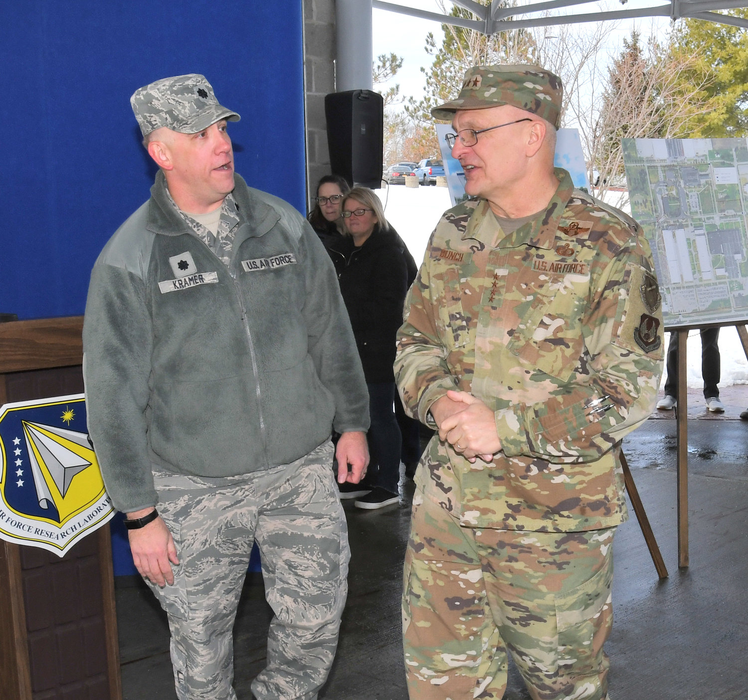 OFFICERS' DISCUSSION — Lt. Col. Thomas Kramer, at left, deputy military commander for Detachment 4 at the Air Force's Rome Lab, talks with Air Force four-star Gen. Arnold W. Bunch Jr. on Wednesday at a ceremony marking the start of construction for a new $13.15 million perimeter security system at the lab. Bunch is commander of Air Force Materiel Command.