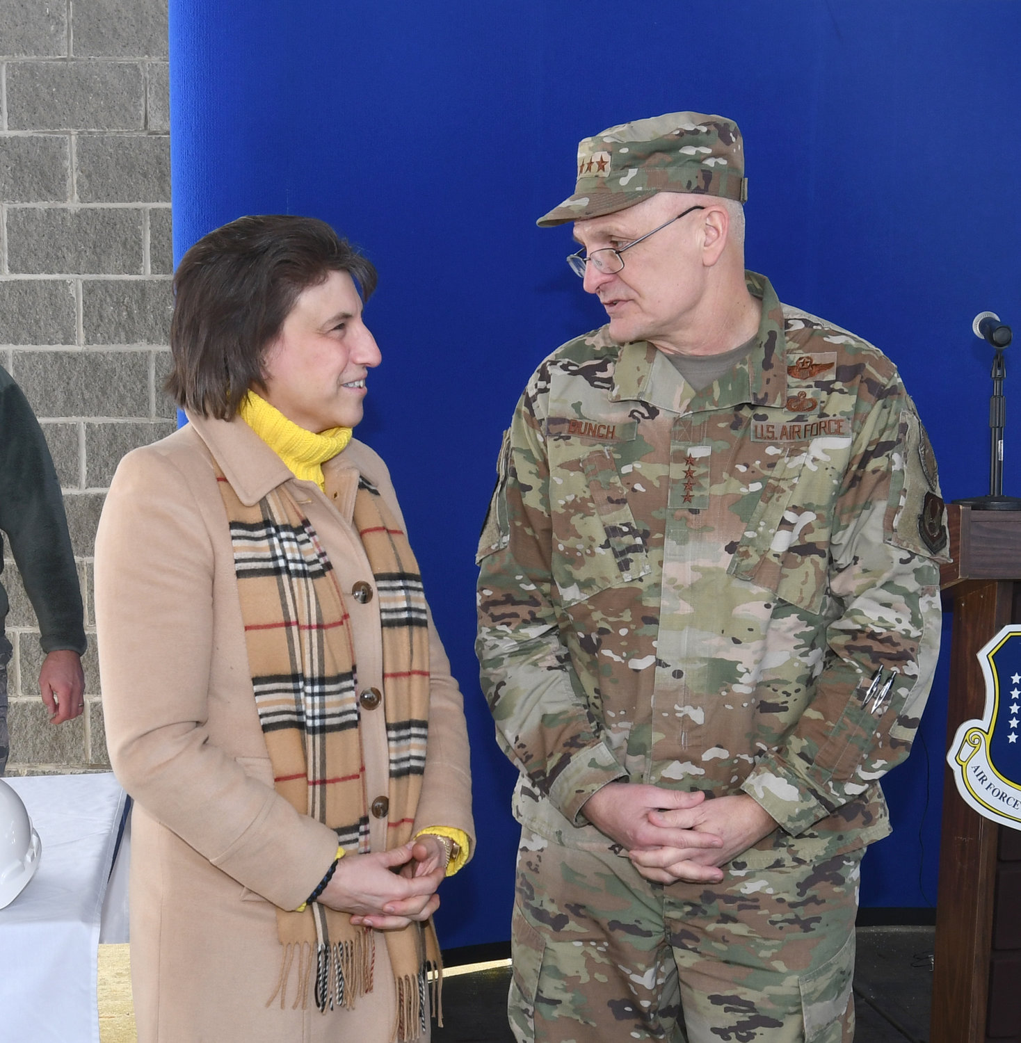 ROME AND MILITARY TOPICS — Rome Mayor Jacqueline M. Izzo talks with four-star Air Force Gen. Arnold W. Bunch, Jr., prior to the start of a groundbreaking ceremony Wednesday for a new perimeter security system at the Air Force's Rome Lab. Bunch is commander of Air Force Materiel Command.