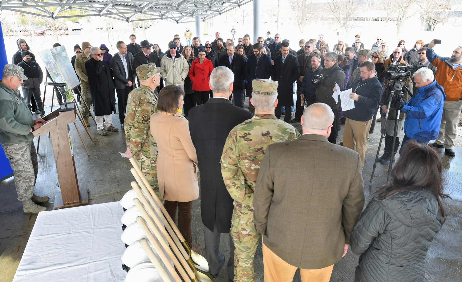 GATHERED FOR CEREMONY — At left, Air Force Lt. Col. Thomas Kramer speaks to the assembled crowd at a groundbreaking ceremony Wednesday for a new perimeter security system at the Air Force's Rome Lab. Kramer is deputy military commander for Detachment 4 at the lab.