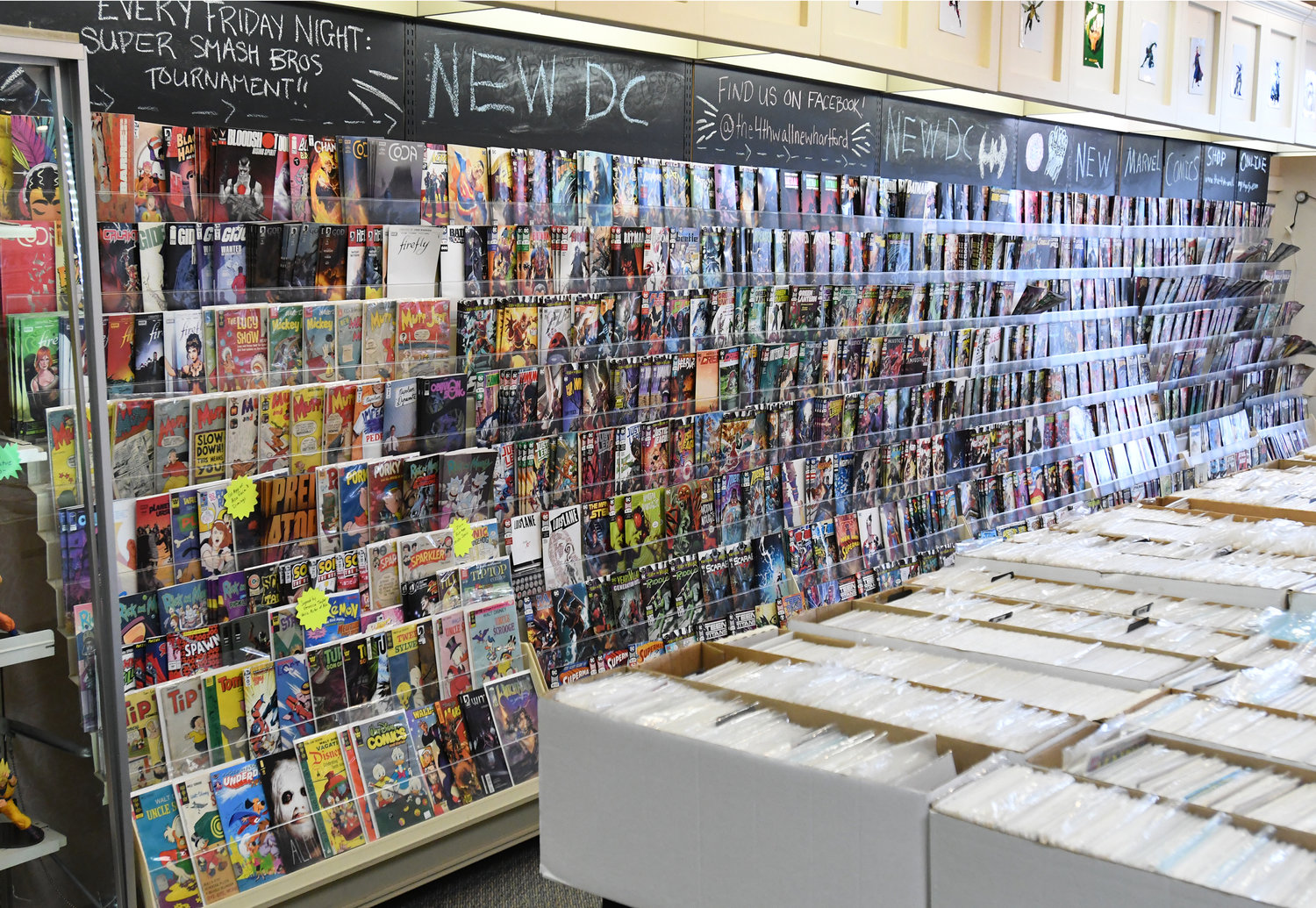 NEW AND OLD COMICS — The 4th Wall comics and collectibles shop features both brand new comics and back issues from all major publishers.