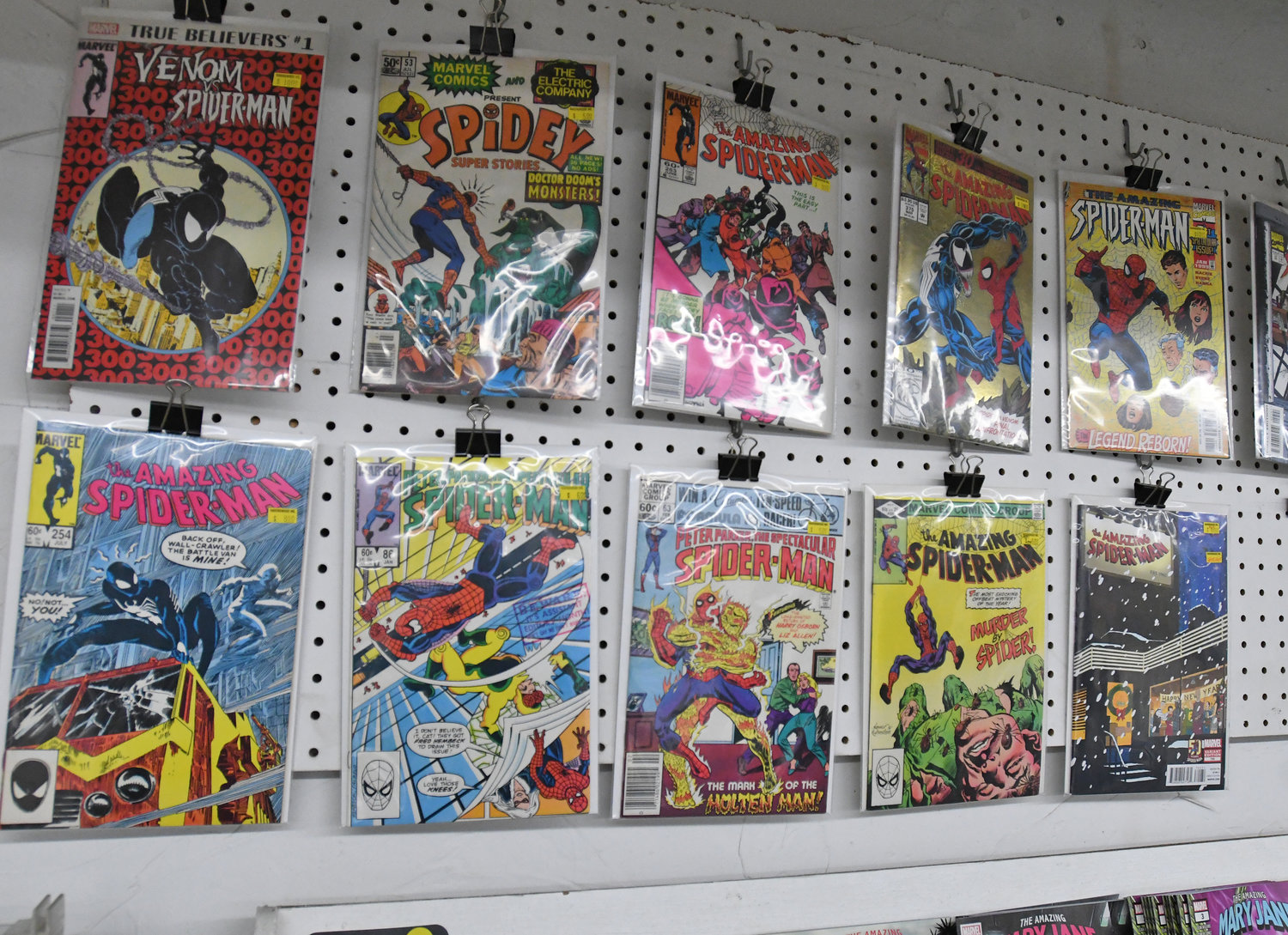 POPULAR ISSUES — With more than 30 years in business, Ravenswood comics in New Hartford has a rare collection of famous and valuable issues, including these Spider-Man comics.