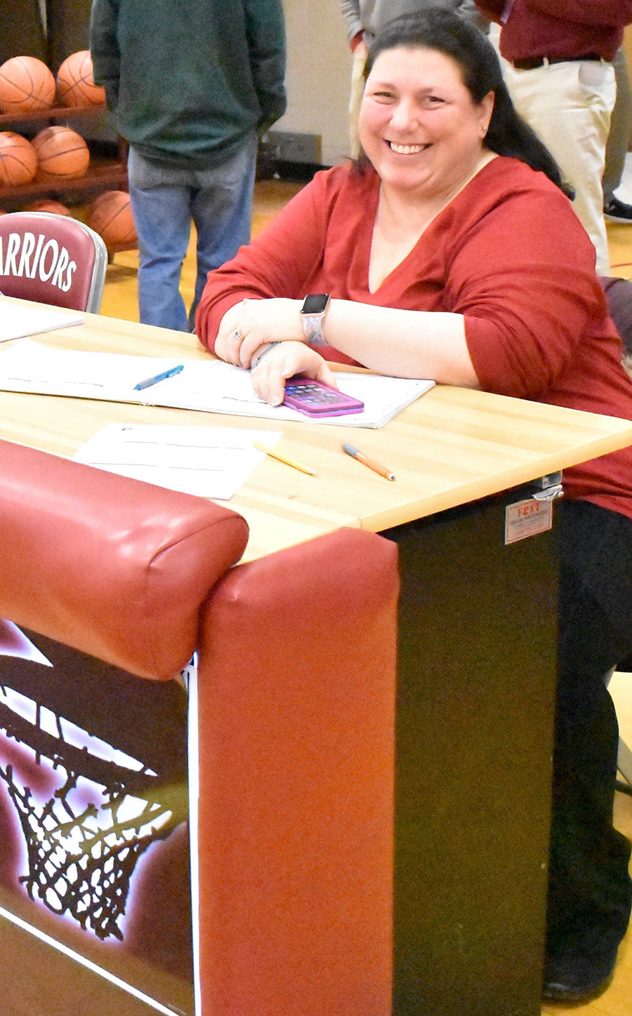 OFFICIAL SCOREKEEPER — Clinton High School basketball is truly a family affair for the Hayduks, of Clinton. Here Gina Hayduk, wife of Dr. Michael Hayduk, deputy director keeps score during a varsity game.  Daughter Lindsay also serves as the team's official photographer.