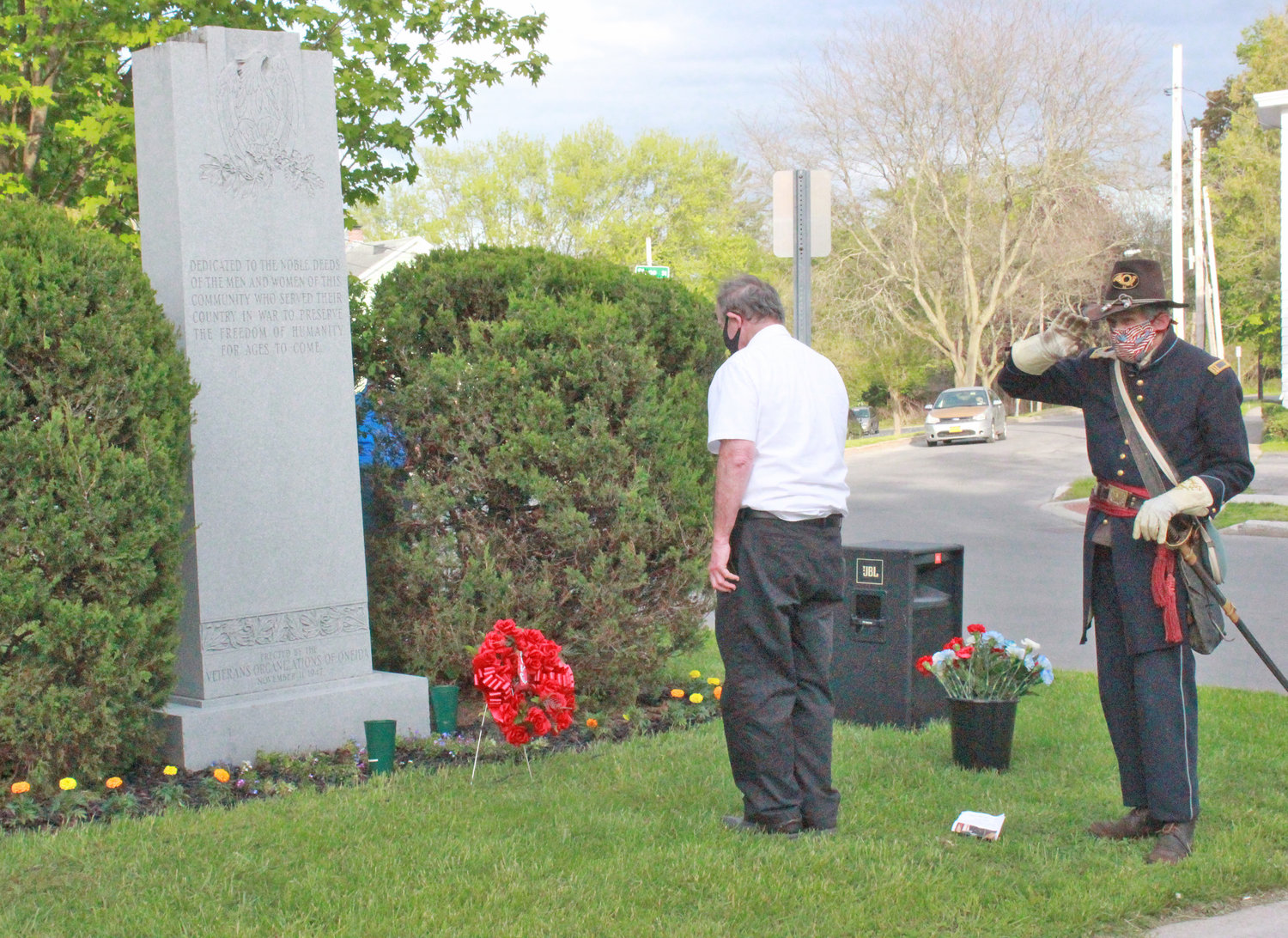 The American Legion Oneida Post 169 and Sons of the Union Veterans of the Civil War place the wreath at the Oneida Memorial Association Memorial Day observance event at Triangle Park on Friday.
