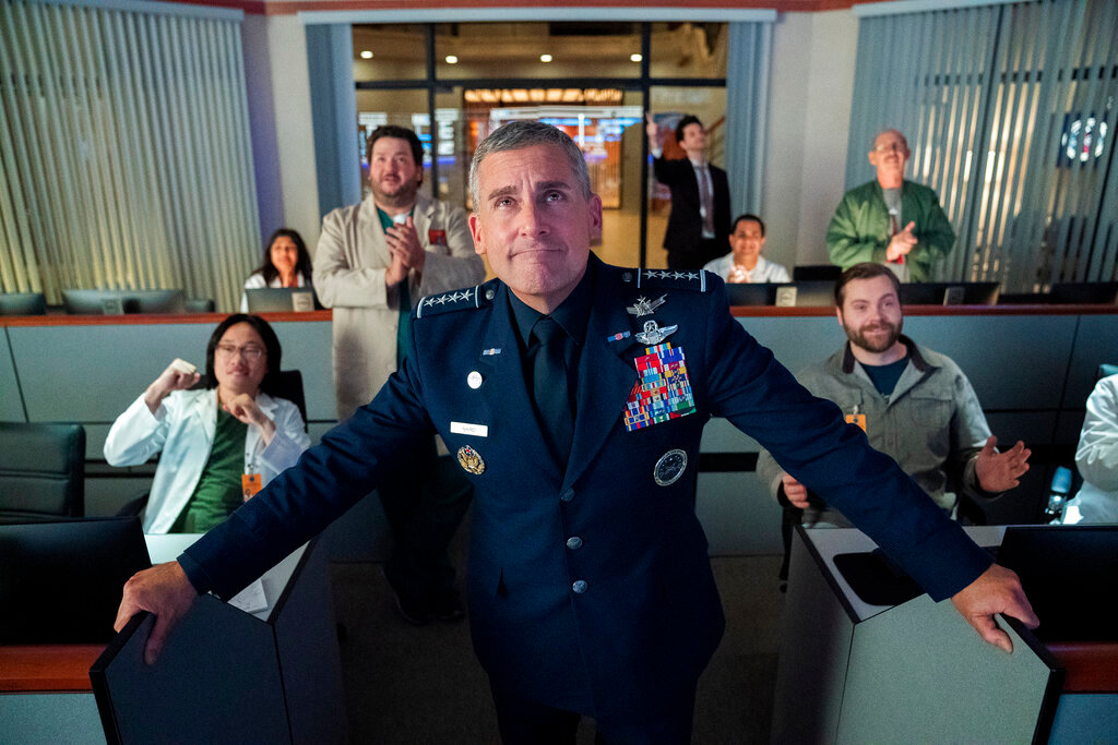 "This image released by Netflix shows Steve Carell, center, from the comedy series ""Space Force,"" available for streaming on Netflix on Friday.  (Aaron Epstein/Netflix via AP)"