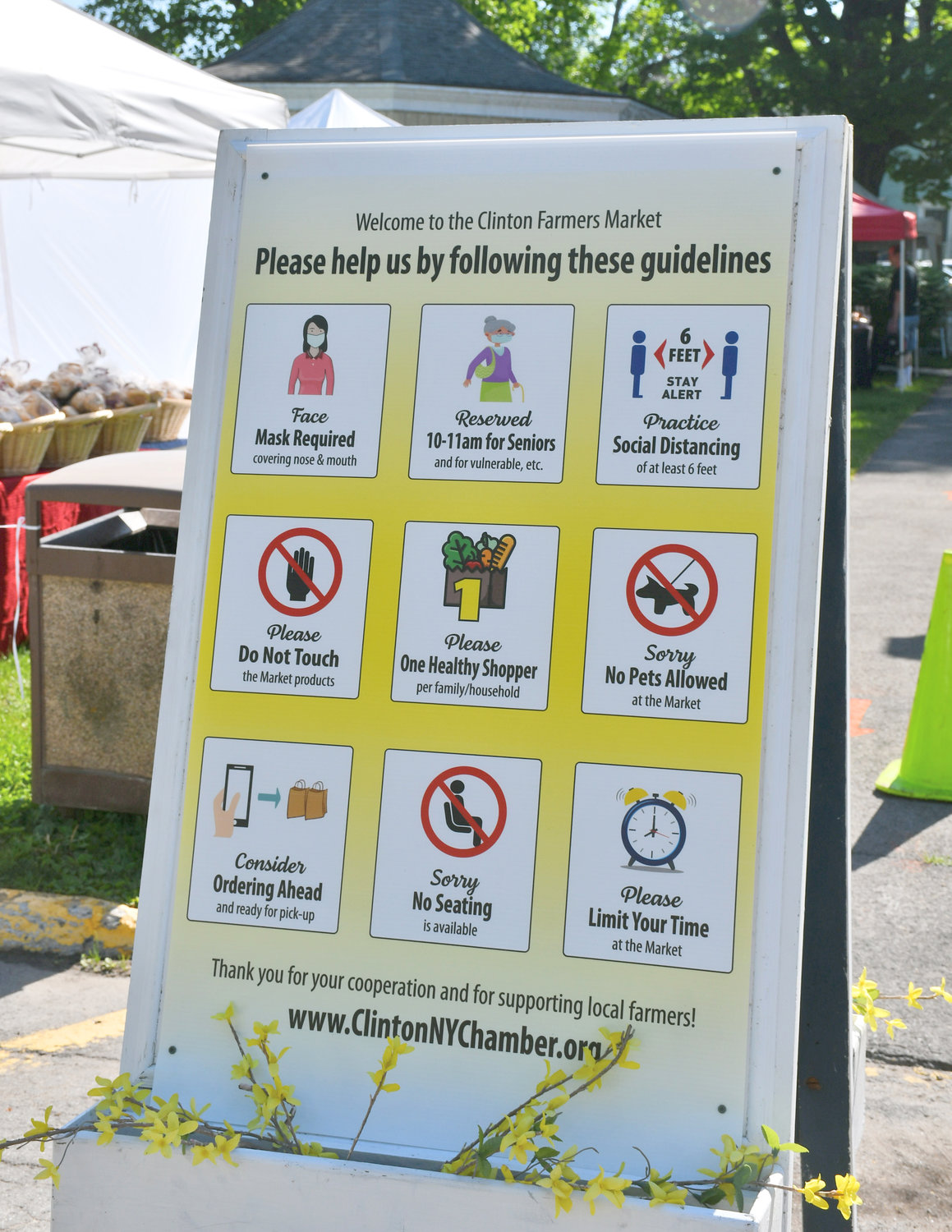 NEW SIGNS — These nine-box, muti-instructional signs are gentle reminders of all that's neccessary in order to make this season's Clinton Farmer's Market possible. The Market will run each Thursday, until Oct.1, on the Clinton Village Green from 10 a.m. to 4 p.m.