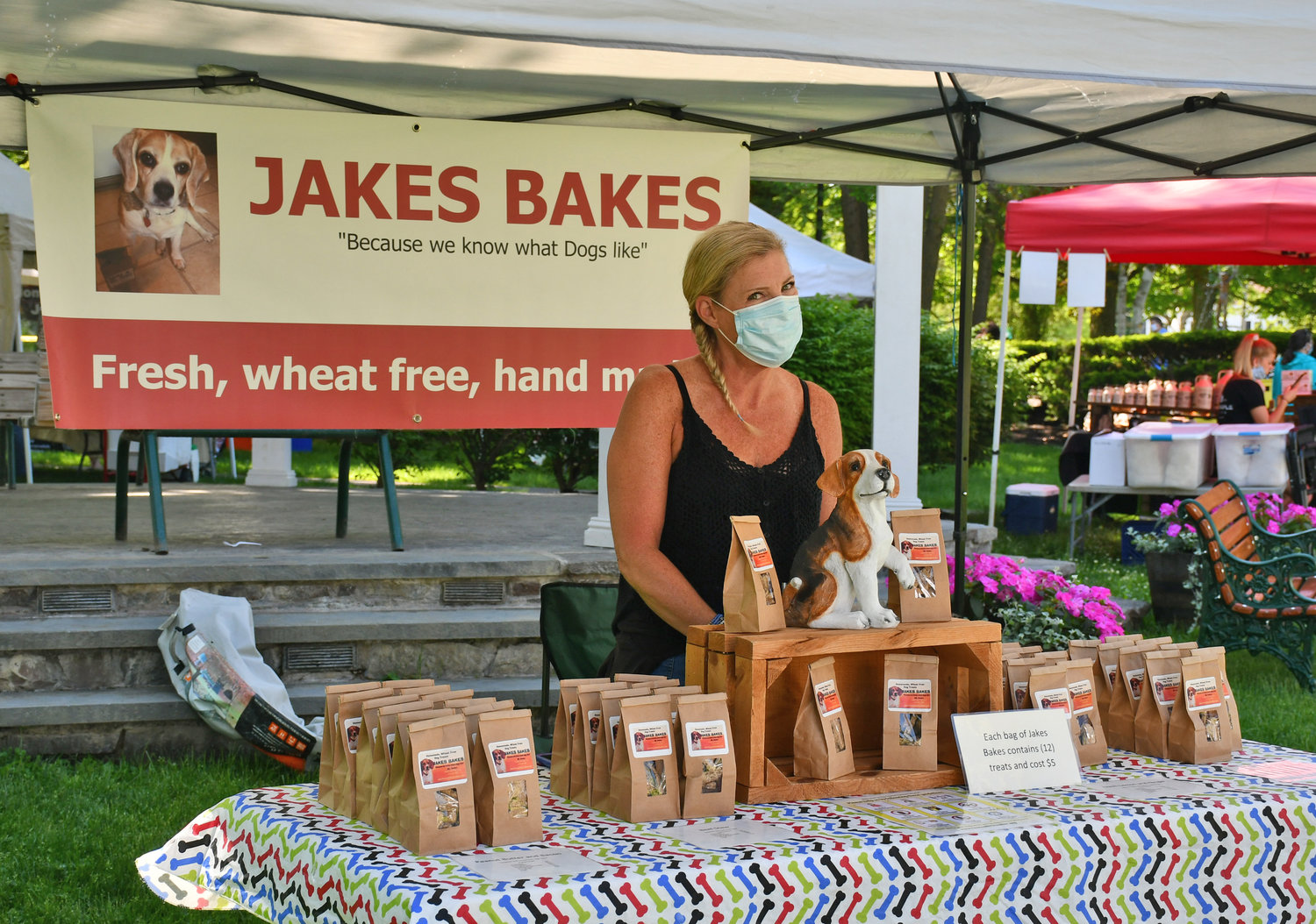 "OBEDIENCE IS KEY — ML Nolan of Jakes Bakes said while the mask is a ""pet peeve"" no one at this year's Clinton Farmer's Market is ""doggin it"" when it comes to following the rules to keep everyone safe. The Market will run each Thursday, until Oct.1, on the Clinton Village Green from 10 a.m. to 4 p.m."