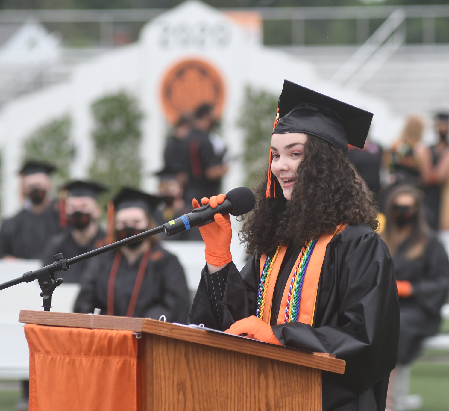 VALEDICTORIAN — Class of 2020 Valedictorian Erika Rizzo shares her message with fellow graduates during the first of six mini-commencement ceremonies on Saturday at Rome Free Academy stadium.