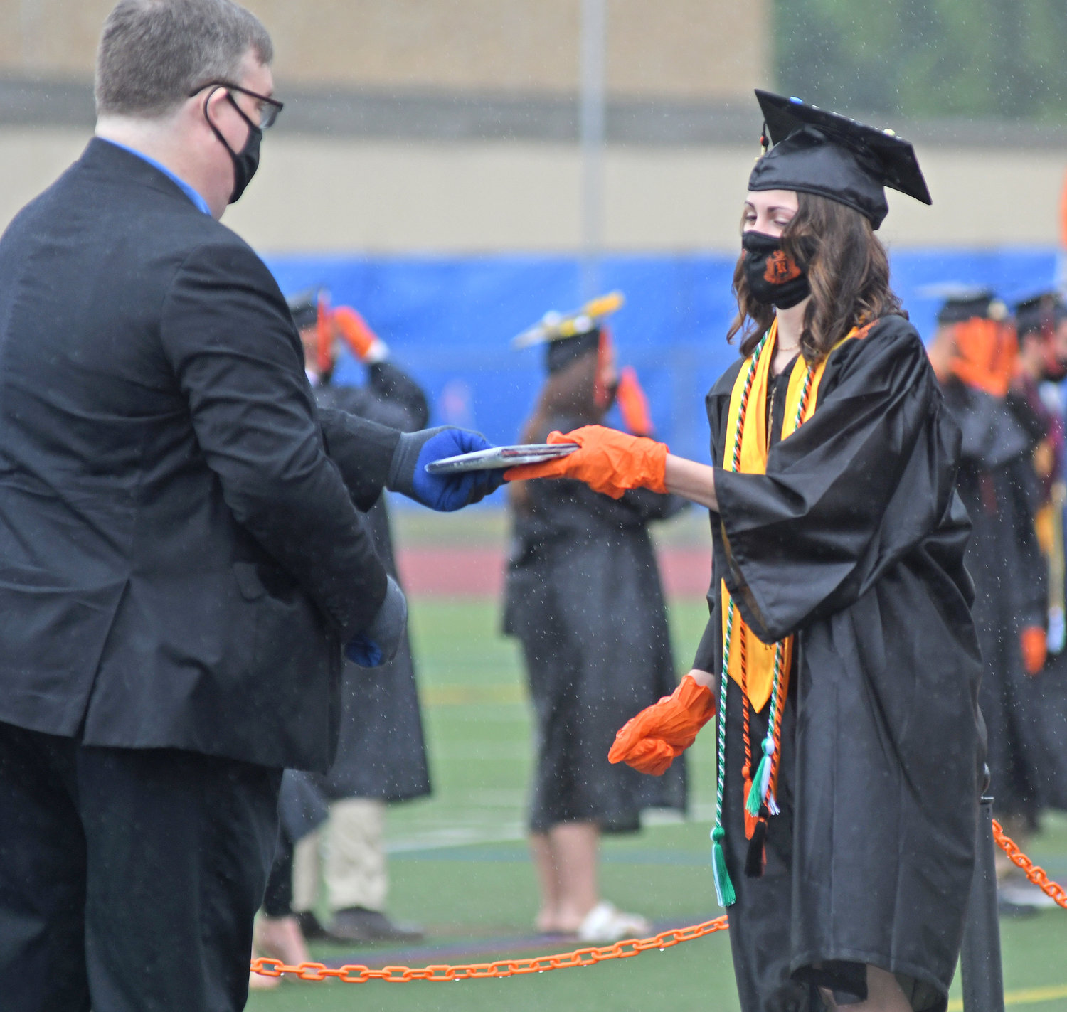DIPLOMA IN HAND — Abigail Minicozzi receives her diploma during a mini-commencement ceremony in June.