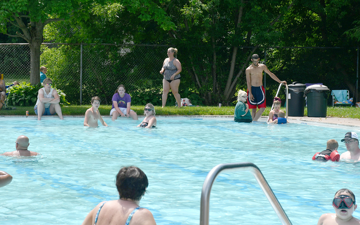 ENJOYING THE WATER — The Clinton Youth Foundation board members and Clinton Pool staff opened the Jack Boynton Community Pool on Sunday, July 5. Pictured here are members of the community enjoying the pool on a warm summer day.