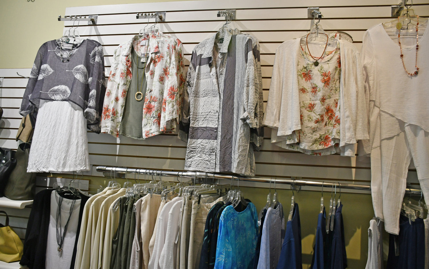 STYLE AND COMFORT — The Village Crossing offers women' clothing lines made from cottons and linens for comfort, along with originality and style you wont find in the average department stores, owner Joyce Polanowizc explained. The shop also carries women's accessories, including handbags, shoes and jewelry.