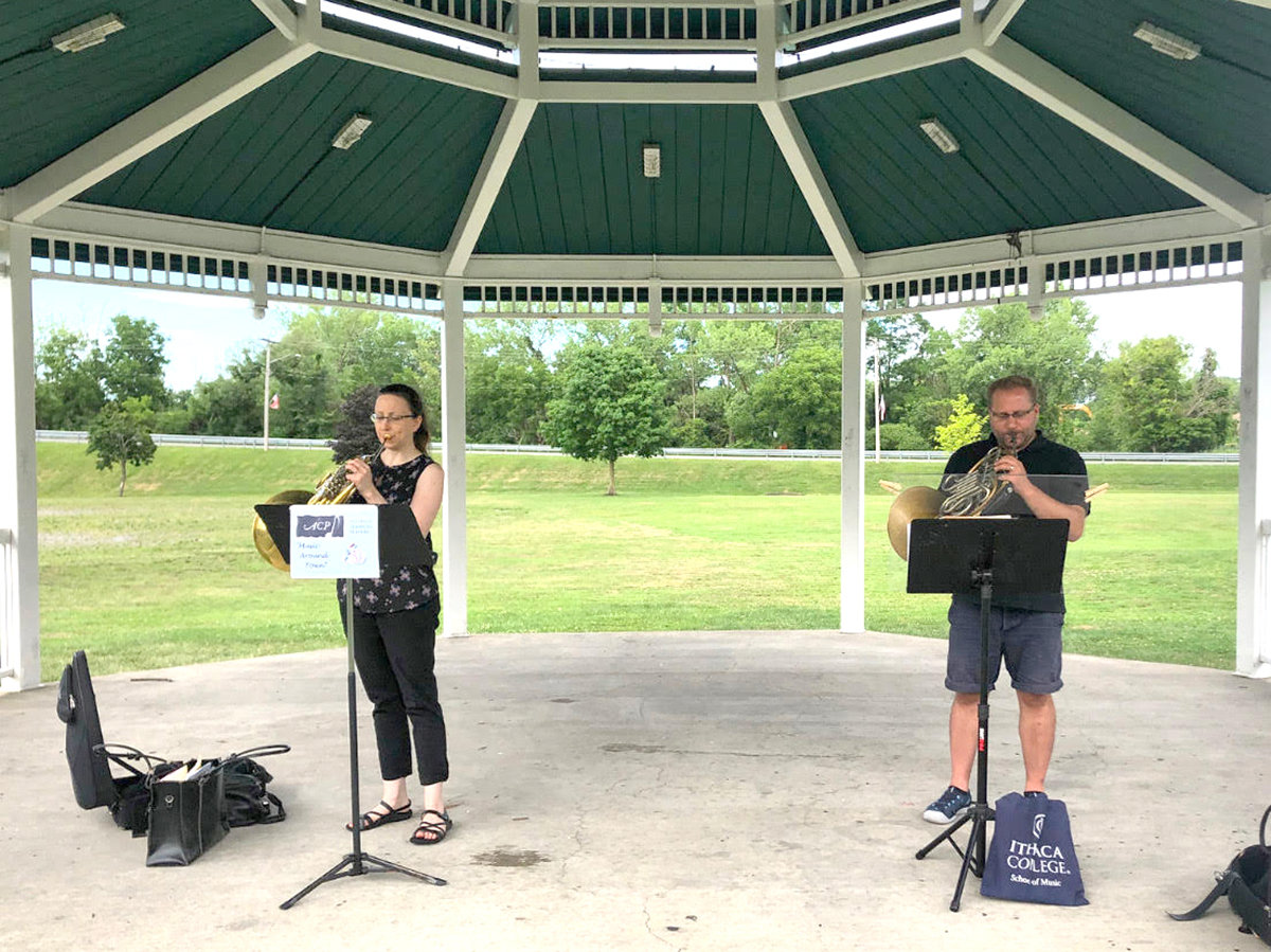 KEEPING THEIR DISTANCE — Alliance Classical Players Horn Duo at Lewis Park in Minoa.