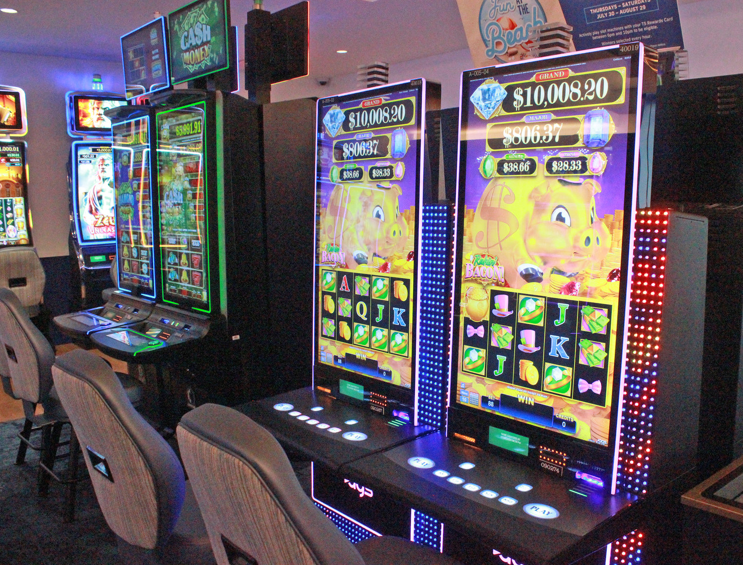 READY TO WIN — Slot machines stand ready and wait to be played before the Lake House's grand opening on Friday, July 24.
