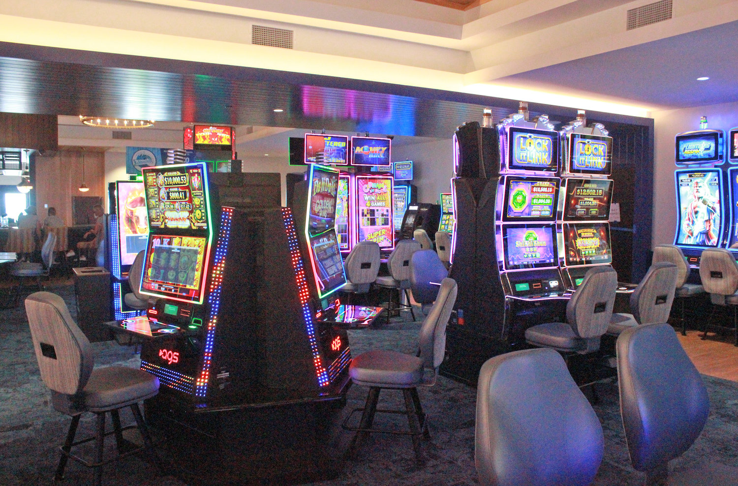 ONE-HUNDRED WAITING — Slot machines stand ready and wait to be played before the Lake House's grand opening on Friday, July 24.