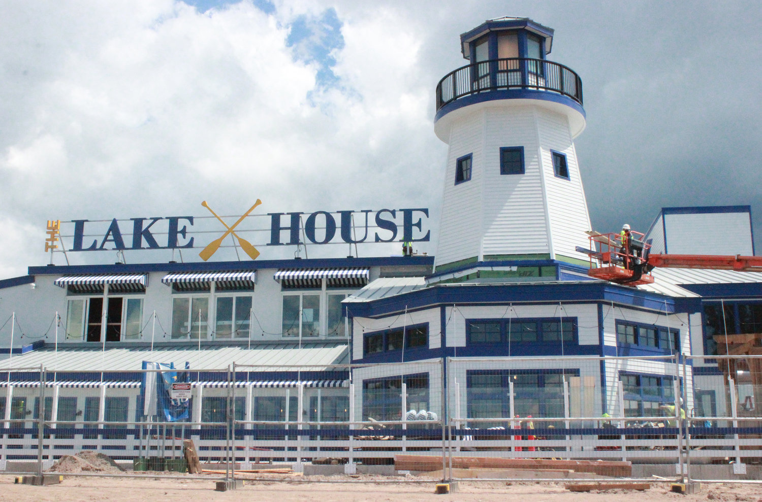THE LAKE HOUSE — The Lake House's iconic lighthouse overlooks the beach, which is barely a stone's throw away for guests.