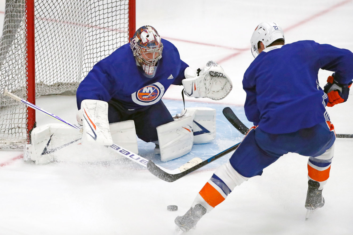 PRACTICE SHOT — Islanders goaltender Semyon Varlamov, left, prepares for a shot by Islanders left wing and captain Anders Lee during an NHL team practice on July 13 at the team's practice facility in East Meadow.