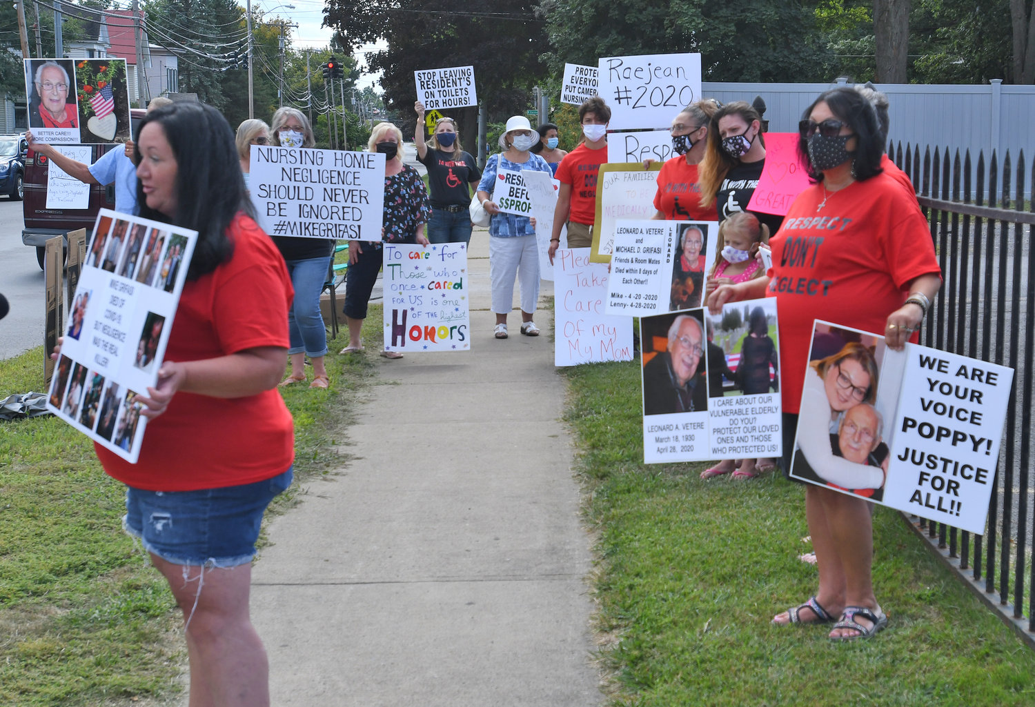 SEEKING CHANGE — Demonstrators gathered outside The Grand on North James Street Saturday afternoon to call attention to care at the nursing facility.