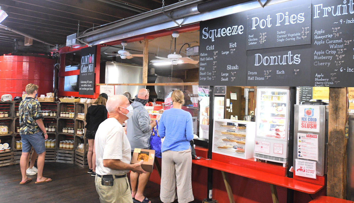 SMELLS OF AUTUMN — Customers line up at Clinton Cider Mill on Elm Street to buy cider, apples and other fall treats, like pot pies, fruit pies, soups, chili and cider doughnuts.  Hours are 10 a.m. to 6 p.m. Monday through Saturday, and from 10 a.m. to 5 p.m. Sunday.