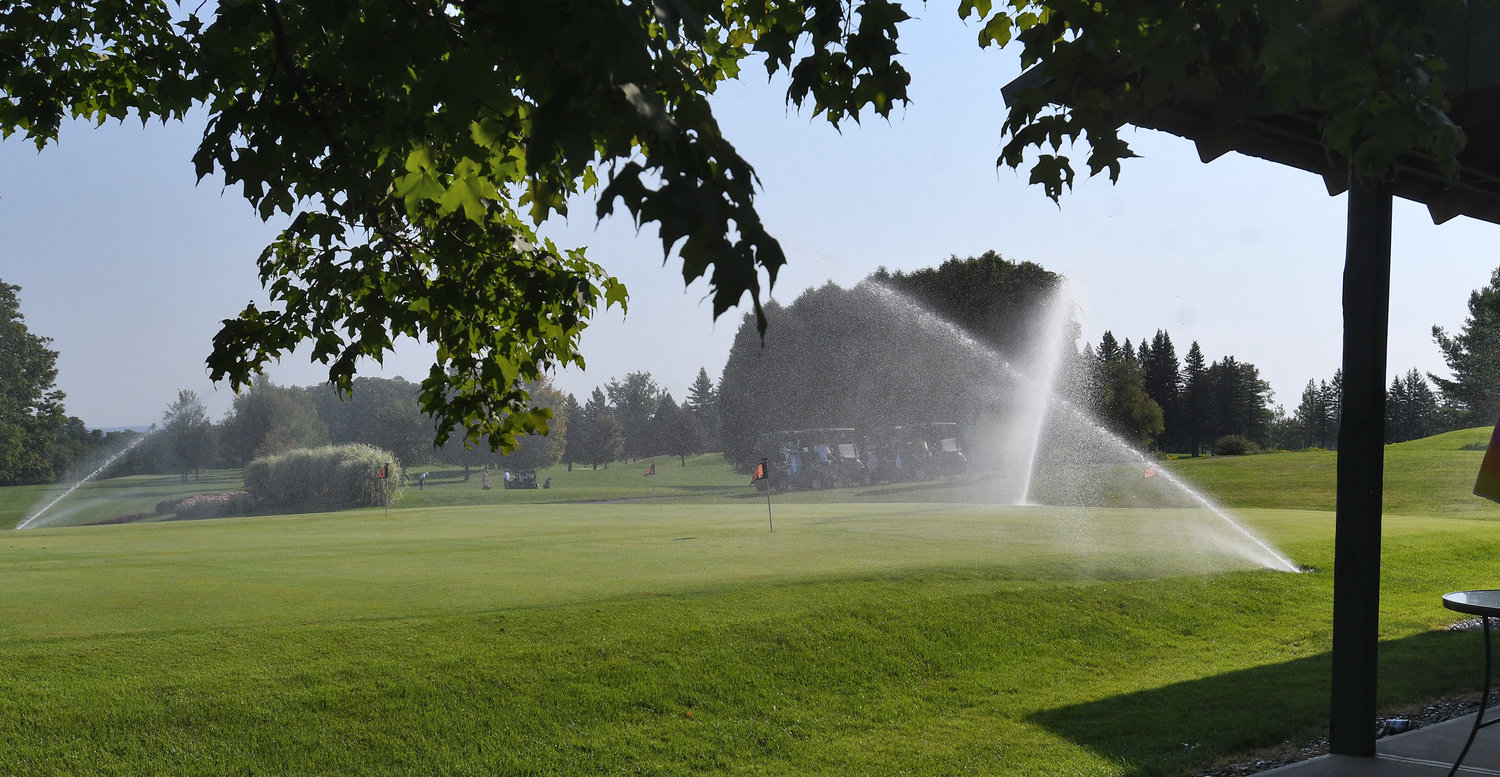 FRESH WATER — Greens being watered at The Skenandoa Club on Wednesday morning.