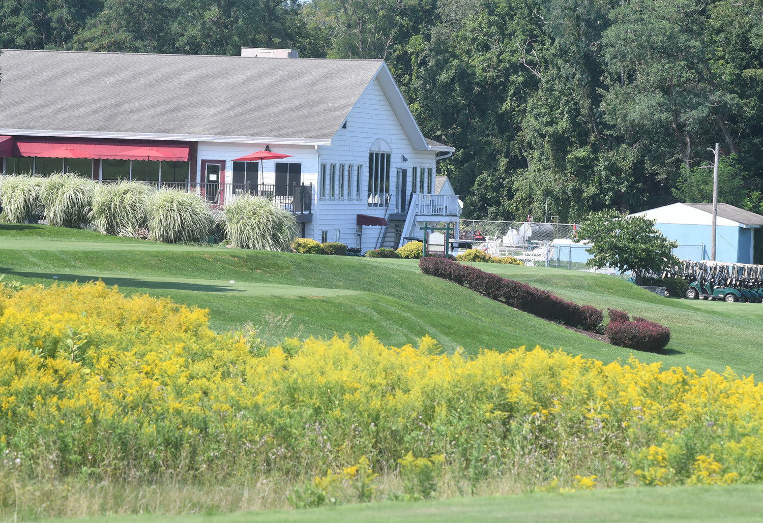 A VIEW OF THE CLUBHOUSE — A shot of the Skenandoa Club clubhouse looking from the ninth hole on Wednesday morning.