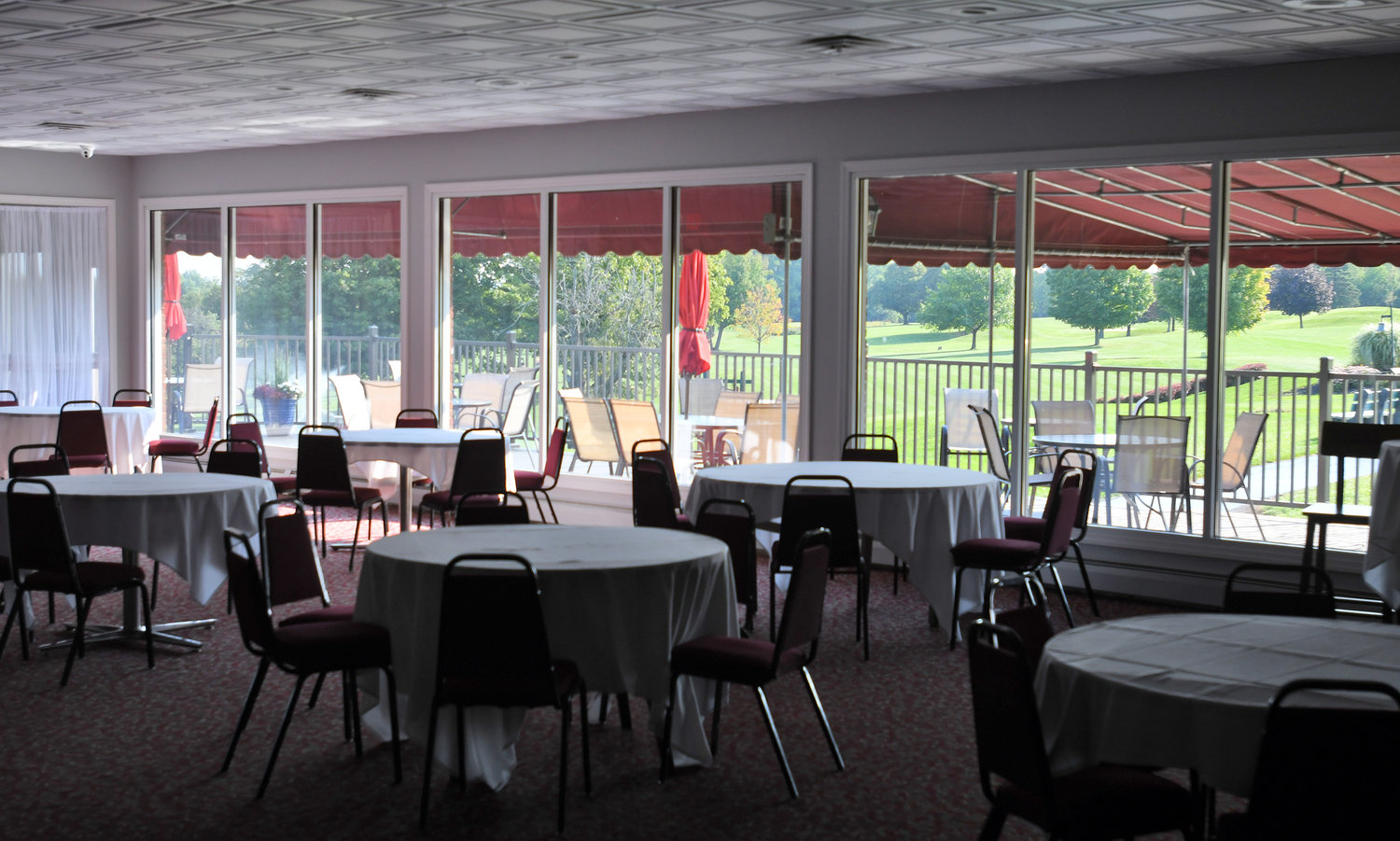 TABLE FOR YOU — Tables sit in the banquet room at The Skenandoa Club. The banquet room is used for wedding receptions and other parties at the club. Some members like to eat their dinner there after playing a round of golf.