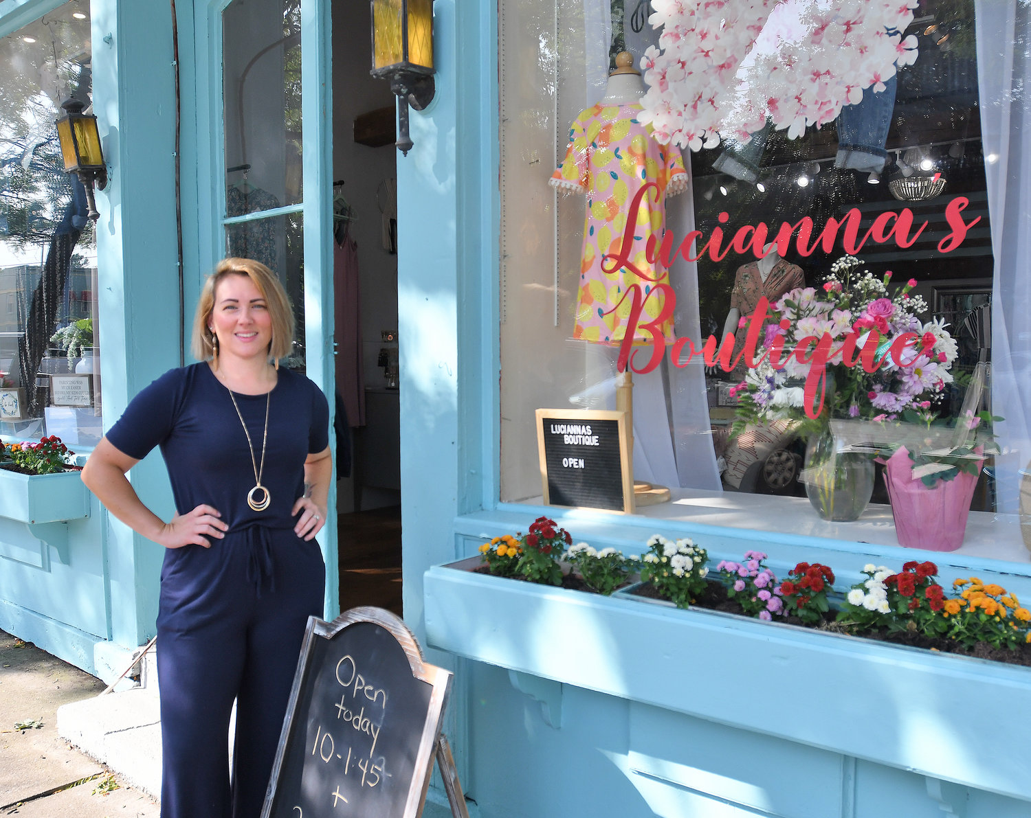 OPEN FOR BUSINESS — Noel Visalli, owner of Lucianna's Boutique, stands outside her location at 13 W. Park Row in Clinton.  The shop will specialize in women's and children's clothing, as well as housewares and homemade goods by local artisans.