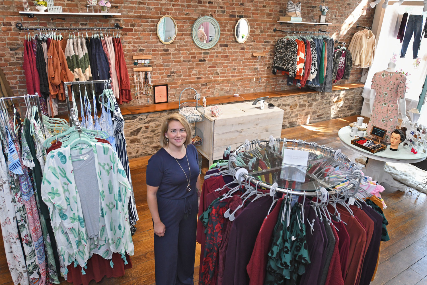 A LOVE FOR FASHION — Noel Visalli, owner of Lucianna's Boutique at 13 W. Park Row in Clinton, shows some of the women's clothing available for sale inside her new shop, located at the former Adirondack Cheese Co. store.