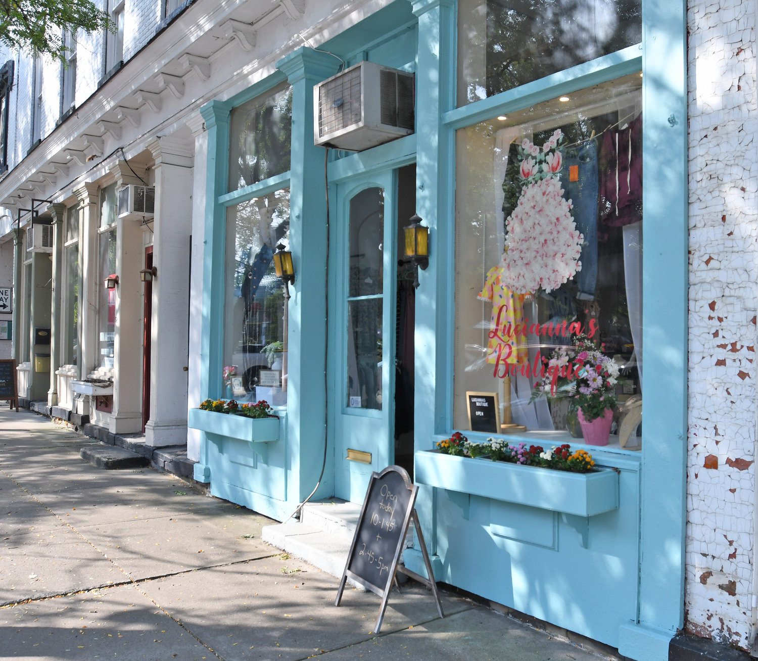 SHOPPERS STROLL — Shoppers in the Village of Clinton can now find the new Lucianna's Boutique, a shop specializing in women's and children's clothing, accessories, housewares and crafts, during their shopping excursions on West Park Row.