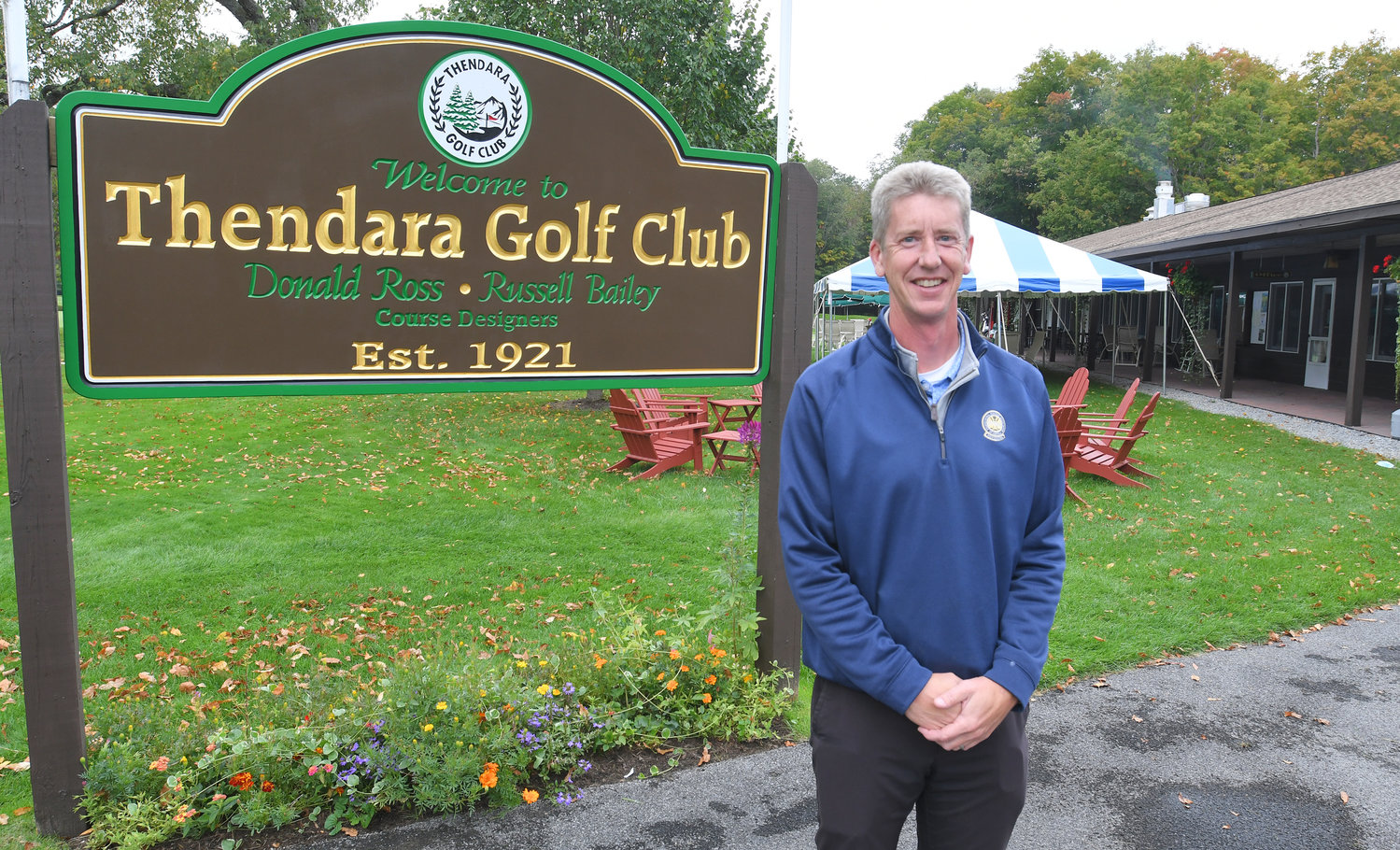 THENDARA GOLF PRO — Thendara Golf Club PGA professional Rich Chapman poses for a photo in front of the sign welcoming players to the club and the clubhouse.