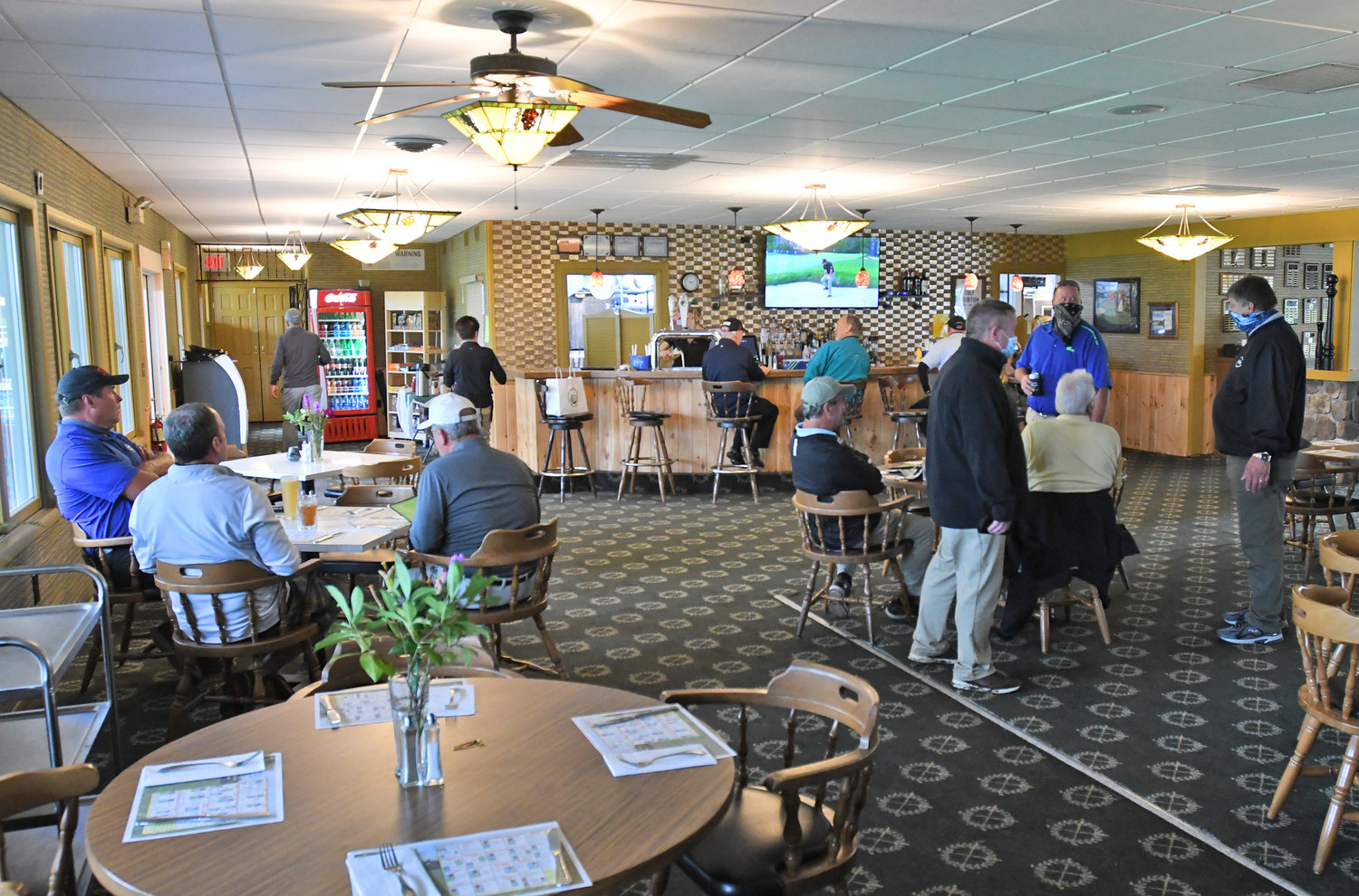 LIVELY CLUBHOUSE — Golfers relaxing after their round inside the Thendara clubhouse.