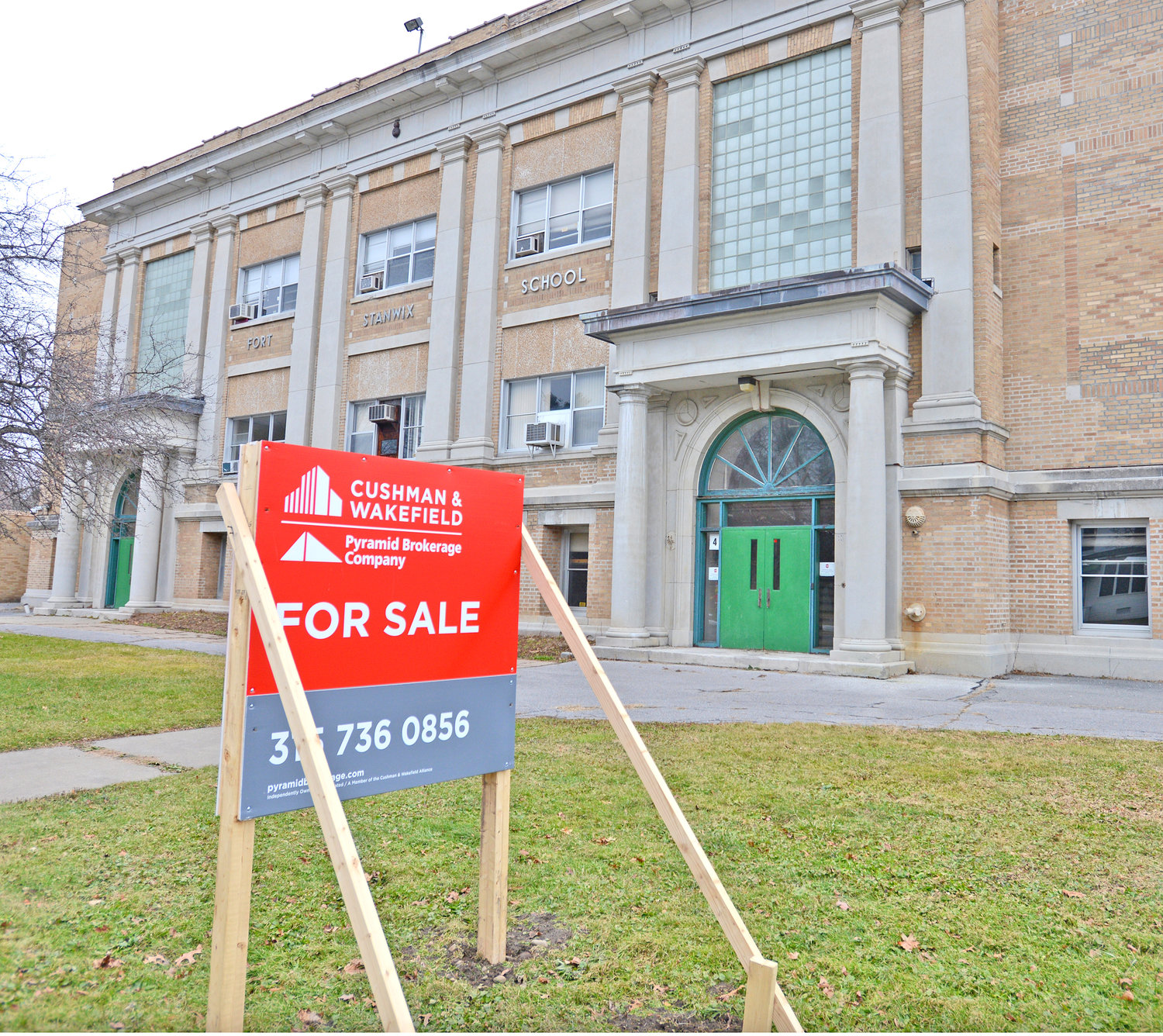 NEIGHBORS EYE PROCESS — Neighbors of the former Fort Stanwix Elementary School, 110 Linden St., are airing concerns over the future of the building, which is slated to turned into an apartment complex for seniors.