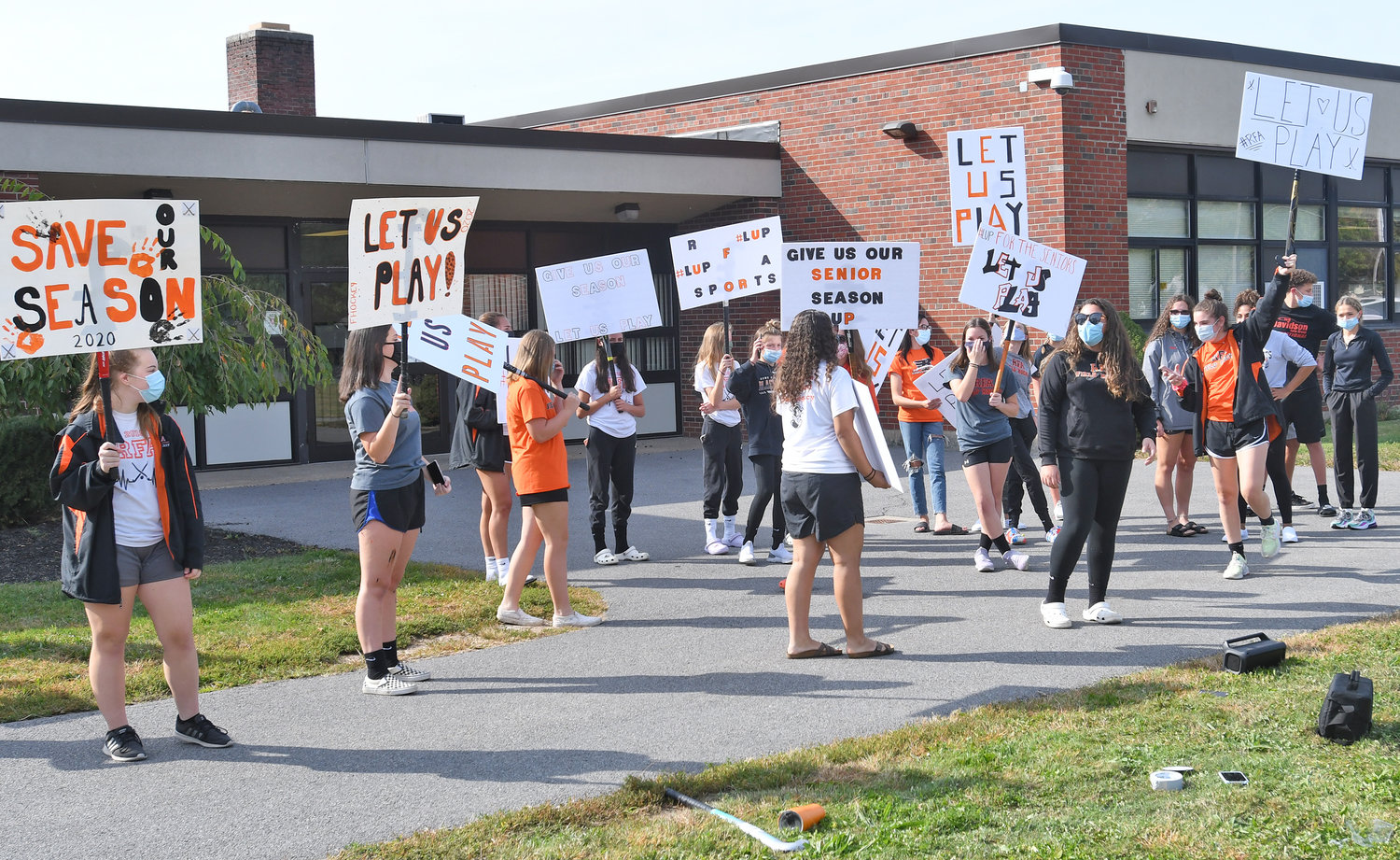 RALLYING FOR SPORTS SEASONS — Student-athletes rally in front of the Rome school district office Thursday afternoon, urging that sports seasons which were planned to begin next week be allowed to proceed. The seasons are now ready to be played, following the Board of Education's approval Thursday night of coaches for the sports involved.
