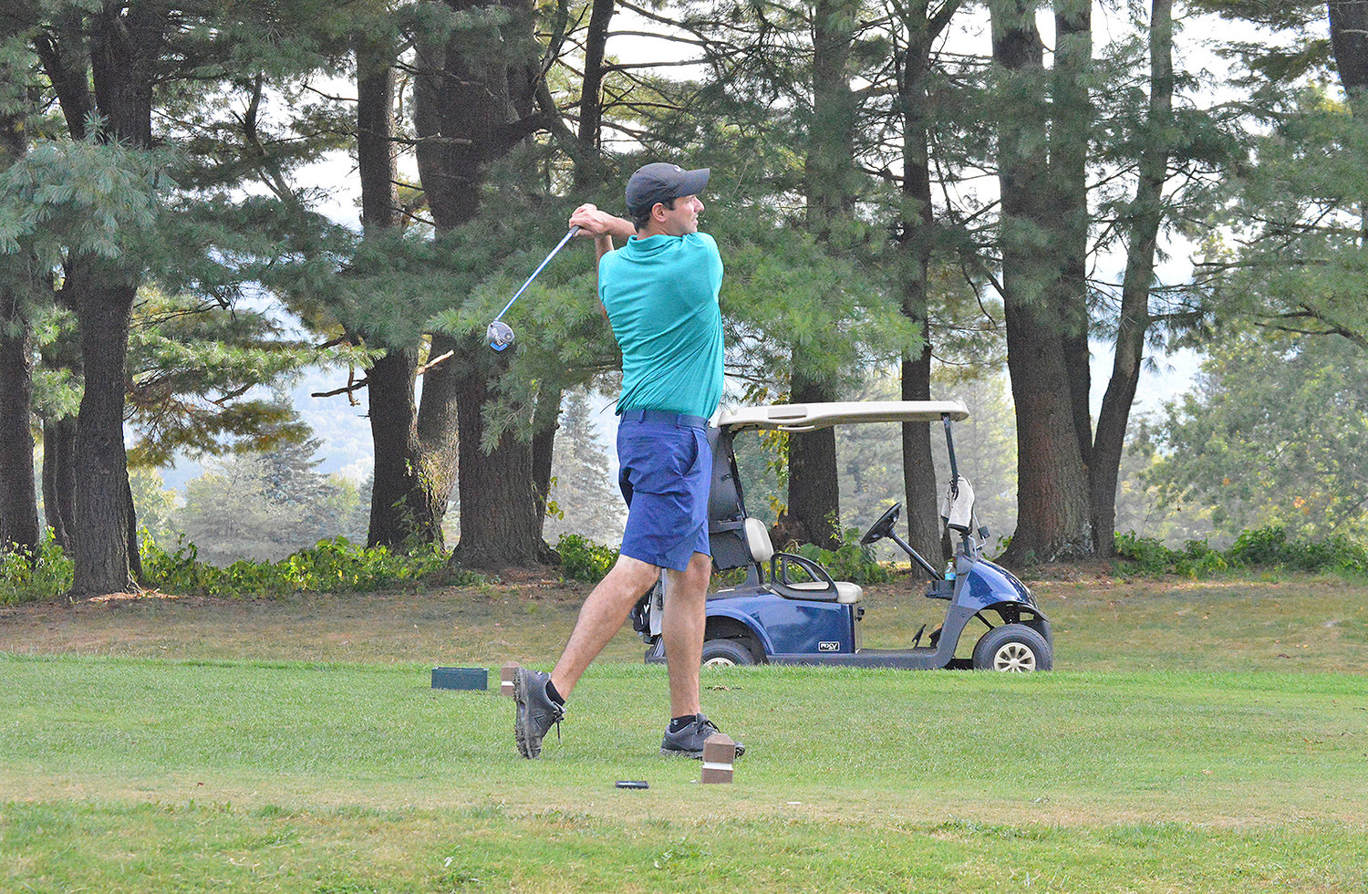 HOLDING THE FOLLOW THROUGH — A golfer holds his follow through on the sixth tee at MV Golf and Event Center on Thursday afternoon.