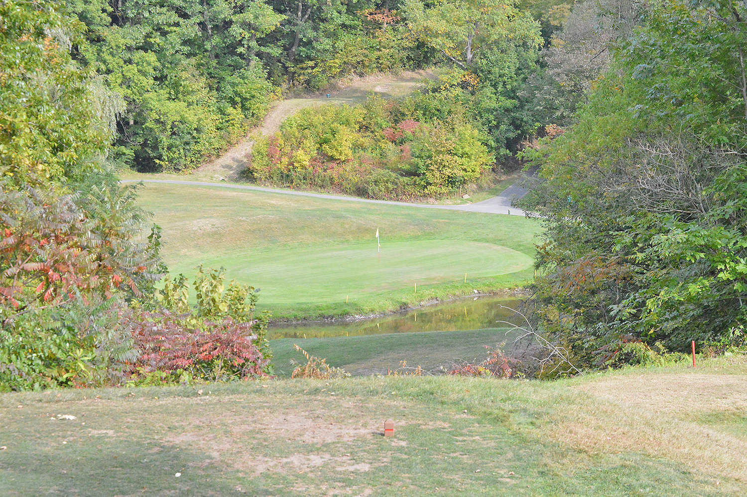OVER THE WATER — A shot looking down onto the third green at MV Golf and Event Center on Thursday afternoon. This hole is the first par 3 of the course, making the player hit over a pond just in front of the green.