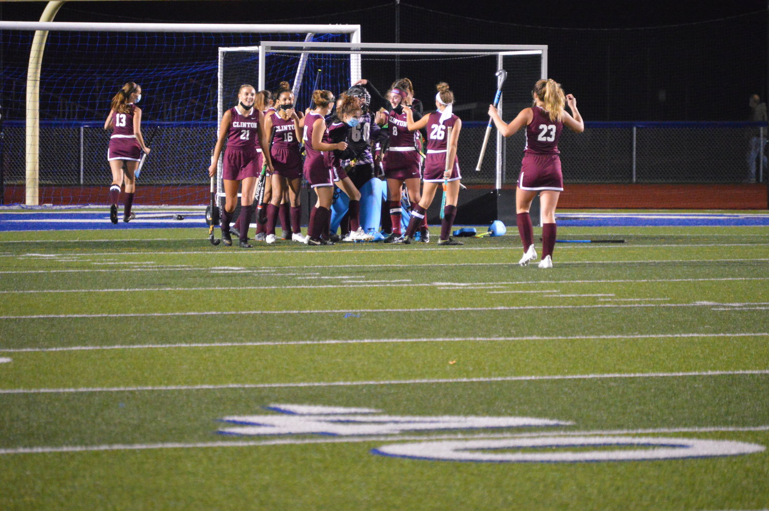CELEBRATING THE WIN — The Clinton field hockey team comes together after defeating the defending Section III Class C champion Camden, 1-0 on Monday night, Oct. 5 in Camden.