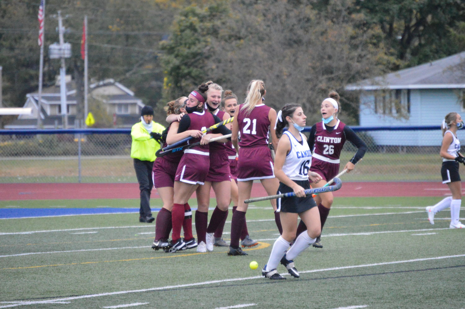 GOAL! — The Clinton field hockey team celebrates a goal scored by Jenna Deep less than 15 seconds into Monday night, Oct. 5's game against Camden. Deep's goal was the difference as the Warriors shut out the Blue Devils, 1-0.